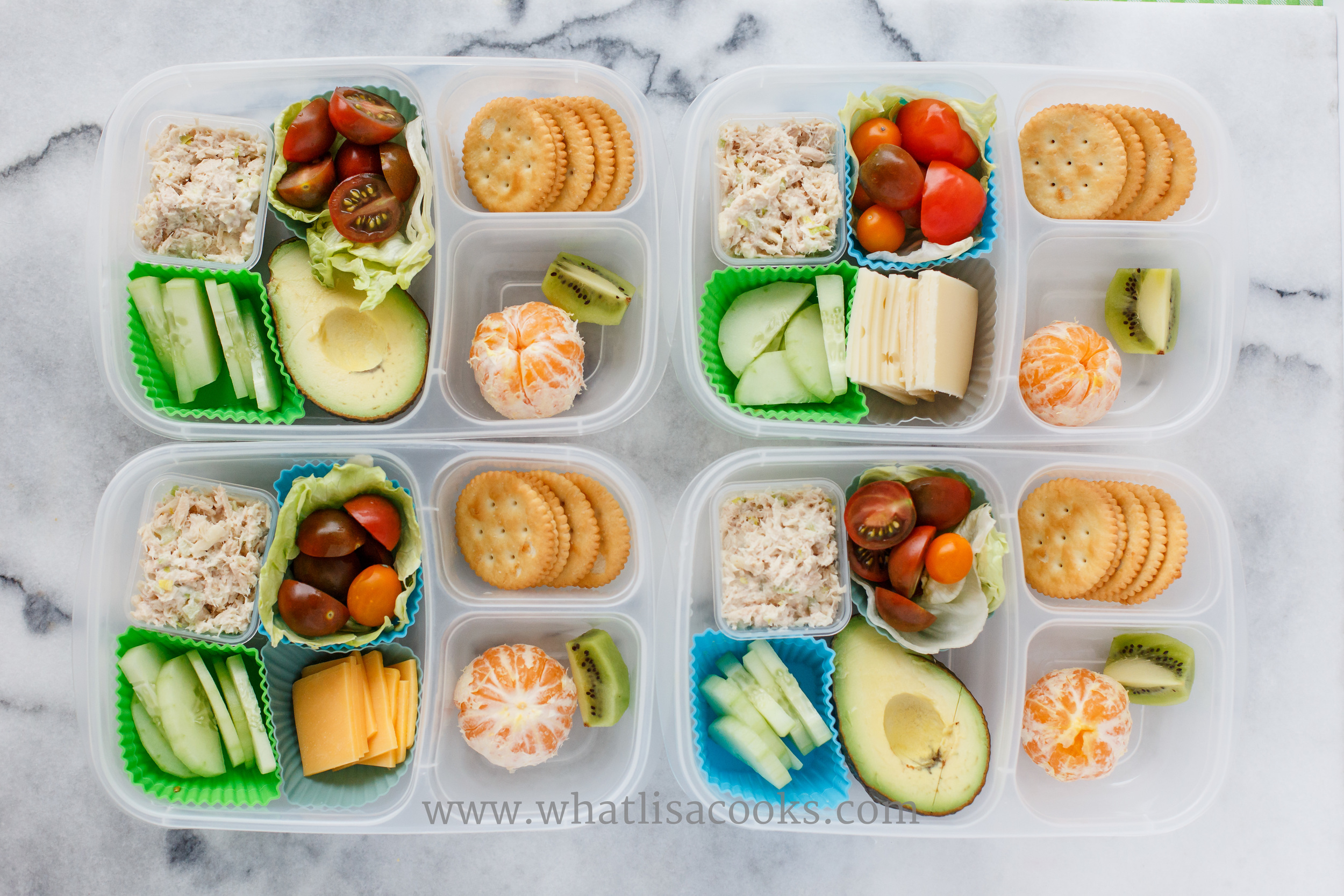 Tuna salad boxes. Simple tuna salad with mayo, celery, celery salt, and shredded mozzarella. With tomatoes in a lettuce cup, cucumbers, cheese, crackers, orange, and kiwi.