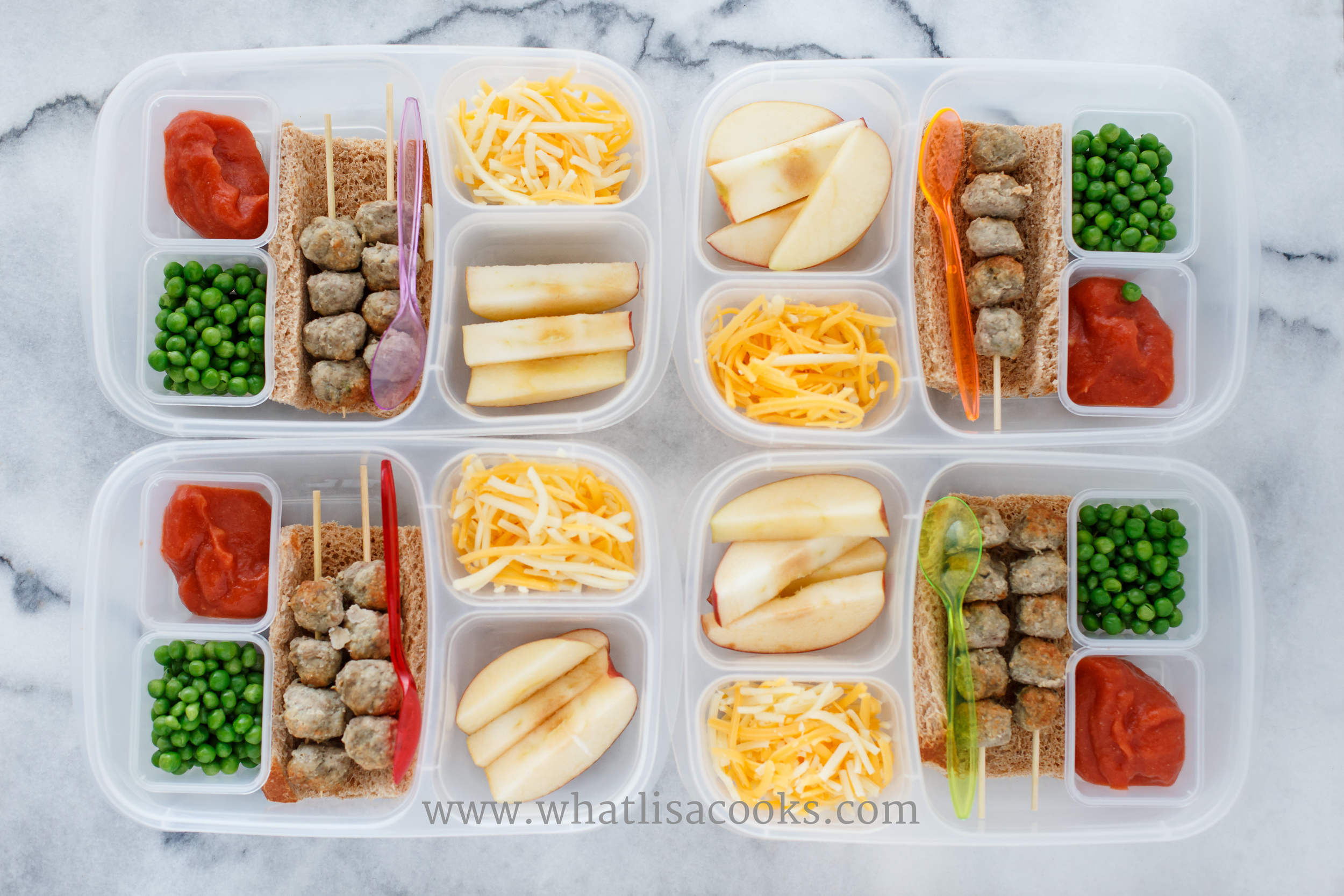 Deconstructed meatball sandwich kits. Tiny meatballs on skewers, bread, tomato sauce, shredded cheese, with peas and apples.