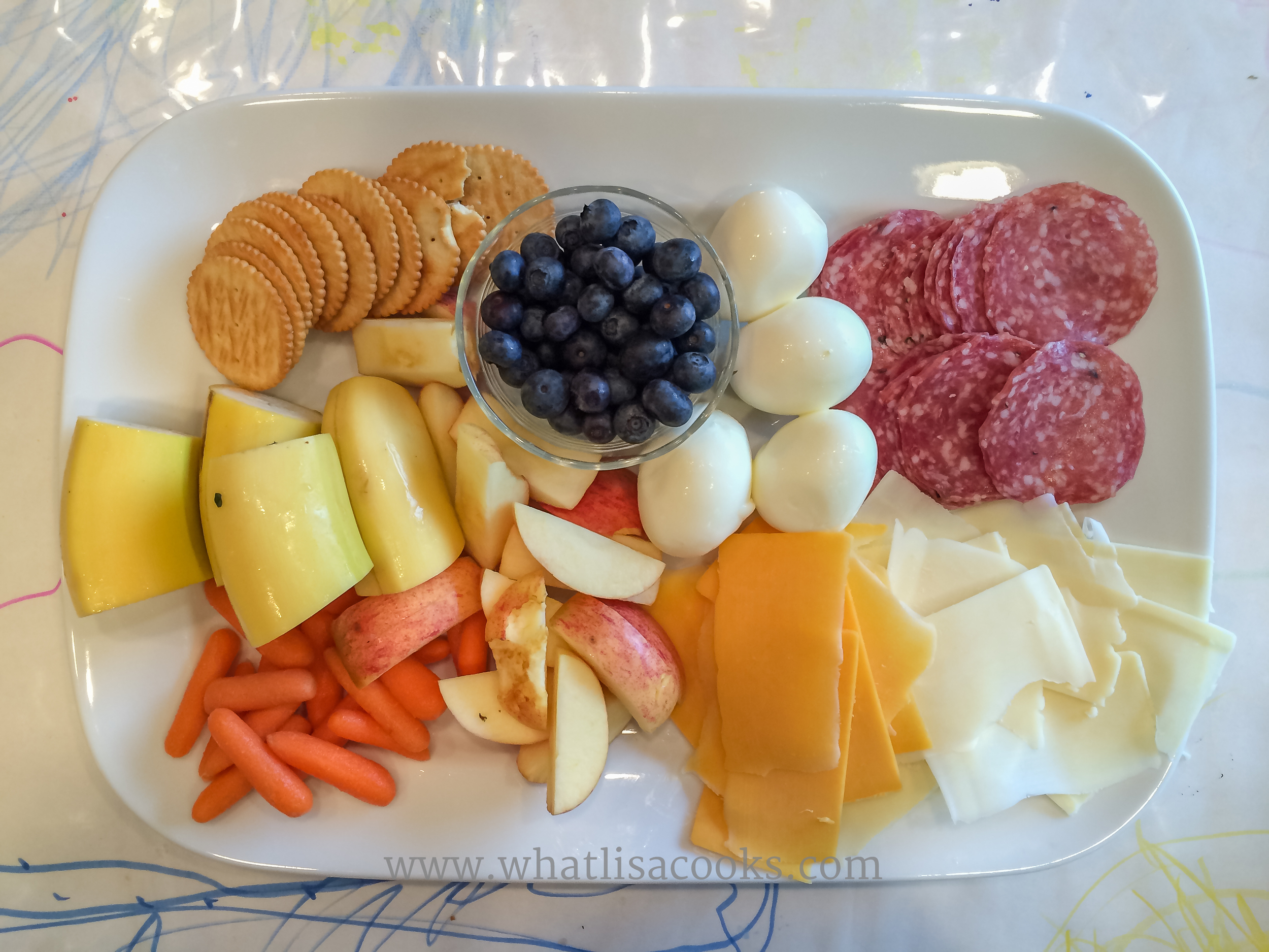 Apples, bananas, carrots, cheeses, salami, boiled egg, blueberries and a few crackers (that was all the crackers I gave for four kids to share).