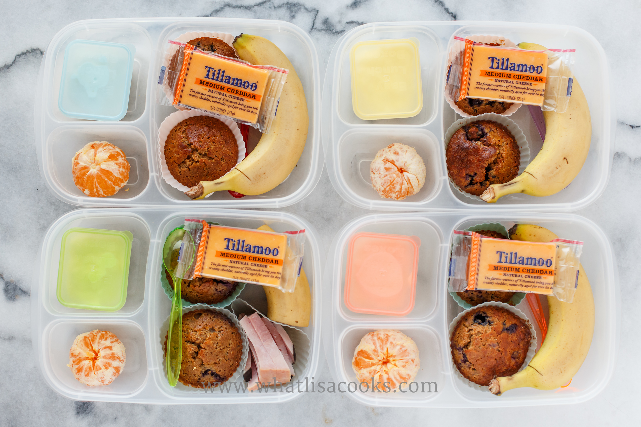 Breakfast for lunch. Whole wheat blueberry muffins from the freezer, banana, orange, yogurt, and one has some ham.
