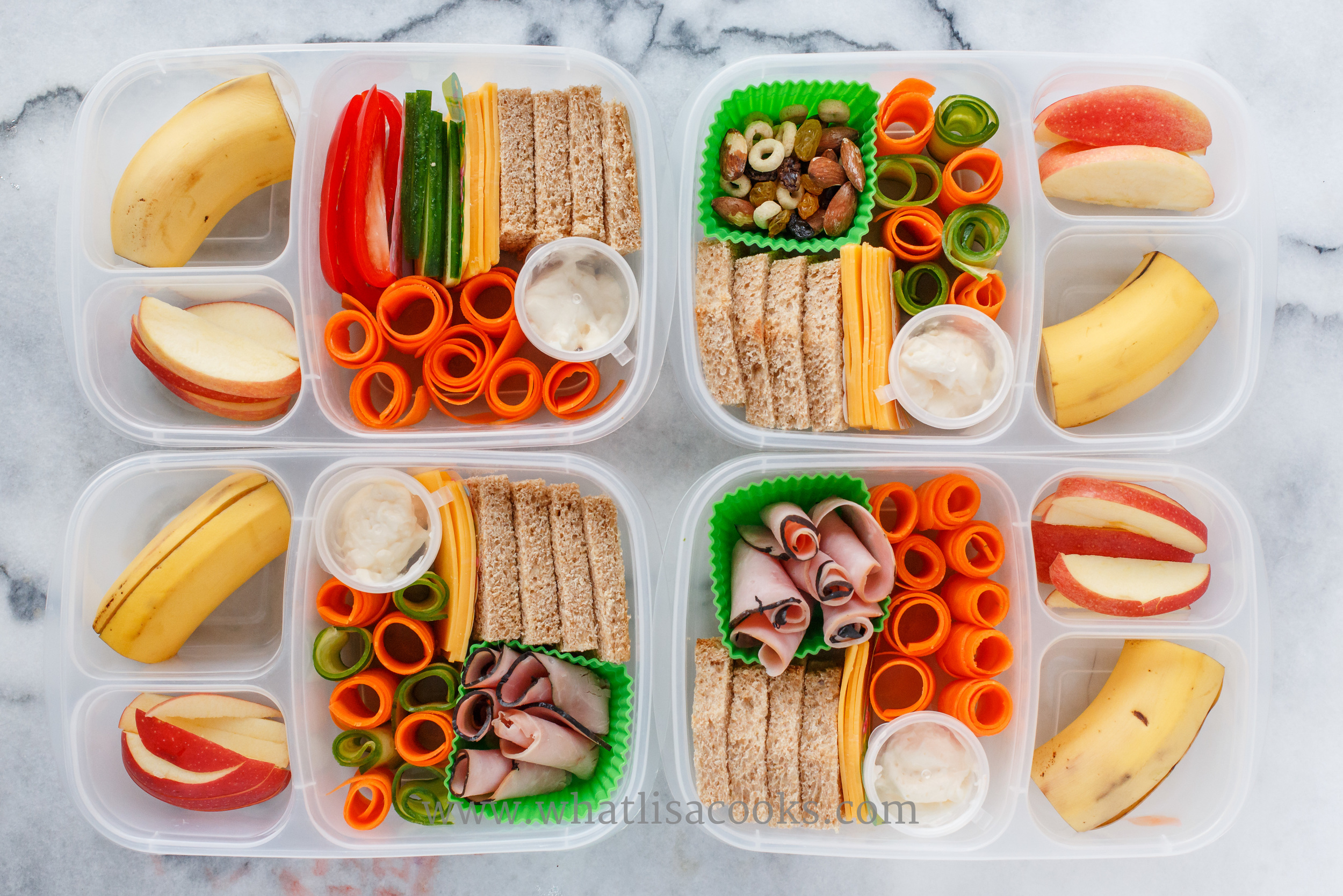 My kids love to make their own sandwiches.  This is one of their favorite lunches.  They have bread, cheese, mayo, and various combinations of veggies and ham.  With apple and banana.