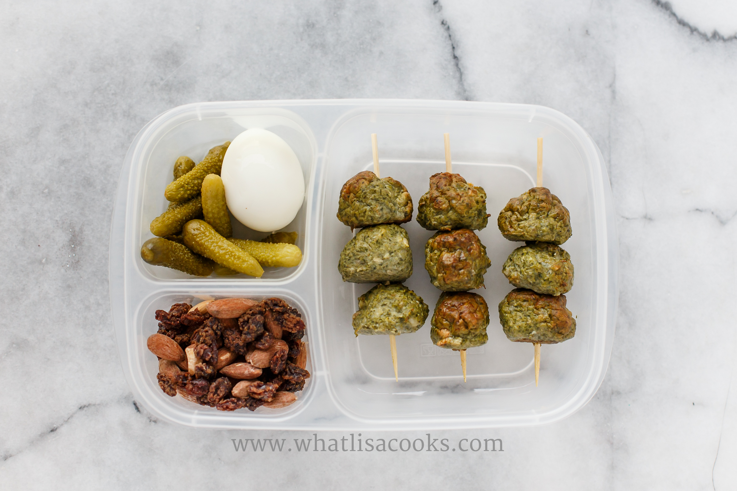 Meatballs with sausage, mushrooms and kale.  Boiled egg, pickles, almonds, raisins.