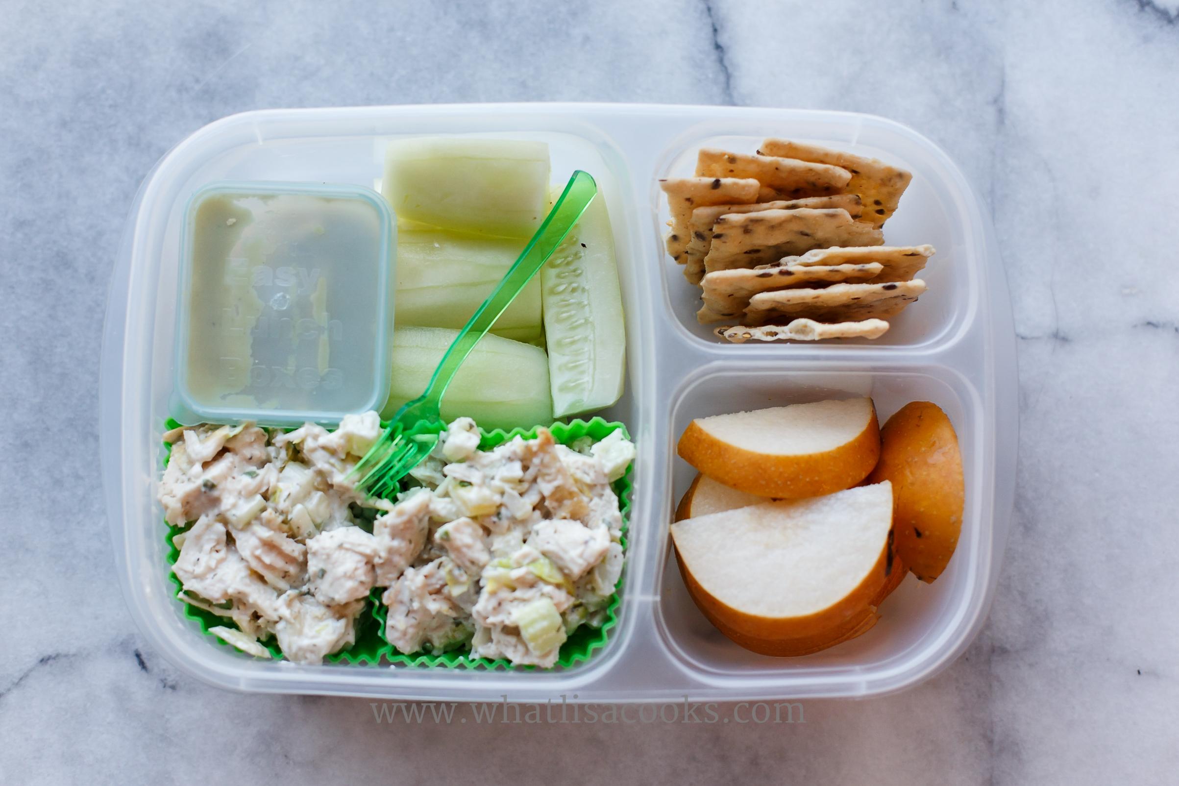 Tarragon chicken salad, cucumbers, guacamole, pears, rice crackers.