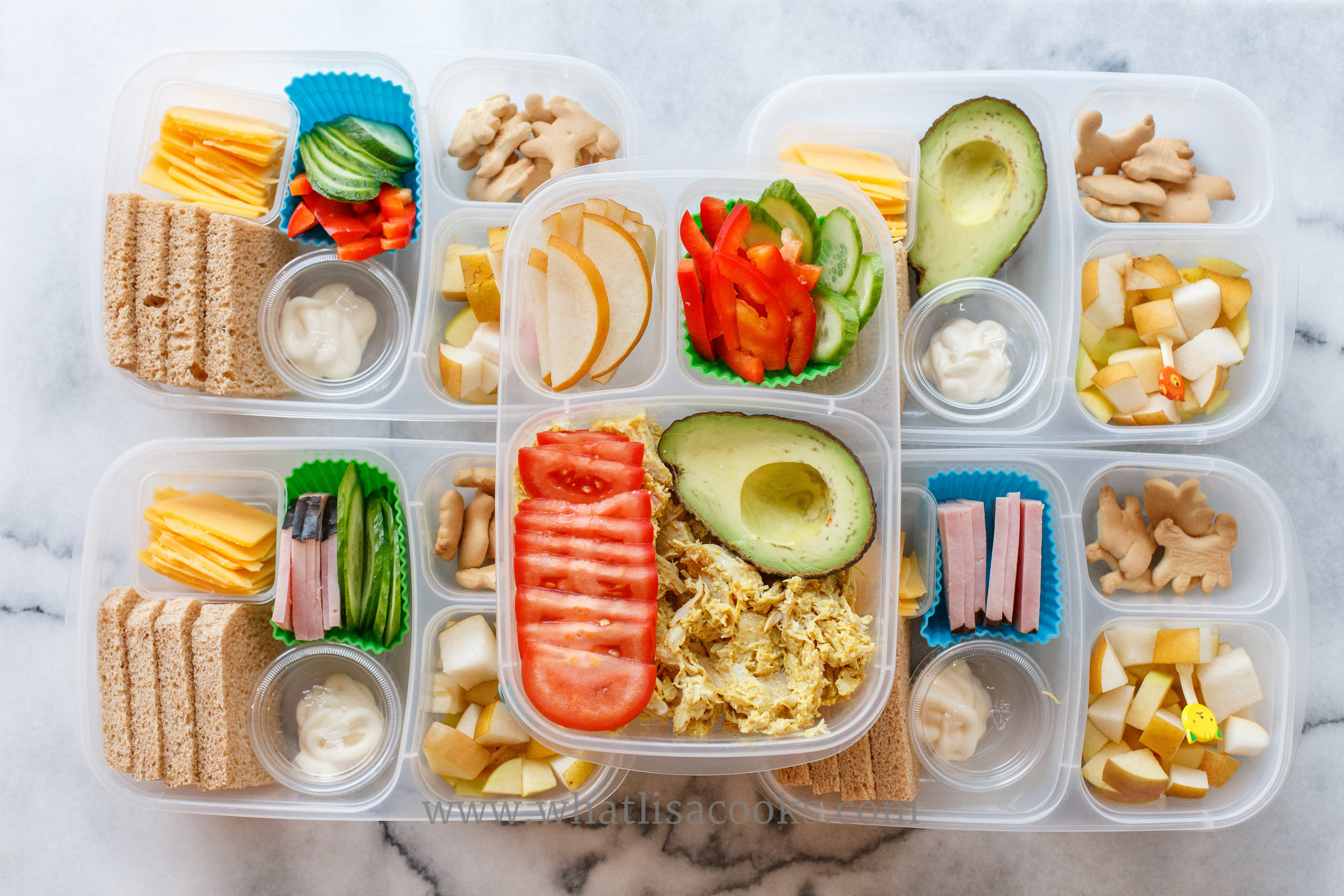 The one on the top middle is grain free: curry chicken salad, tomatoes, avocado, peppers, cucumber, pears. The others have bread and cookies, but this could be made gluten free with gluten free bread and cookies.