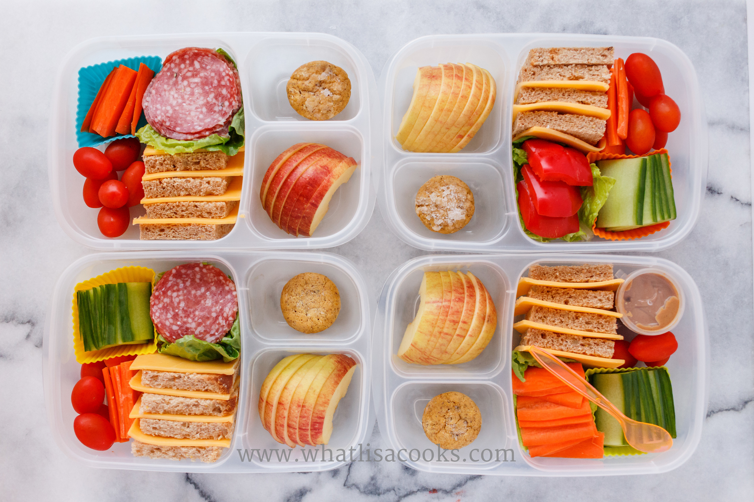This is one of our favorite lunches - the sandwich kit.  I give them bread, cheese, meat, veggies, and they make their own sandwich, or they can just eat all the pieces separately.  One has peanut butter.  They all have apples and a mini muffin.
