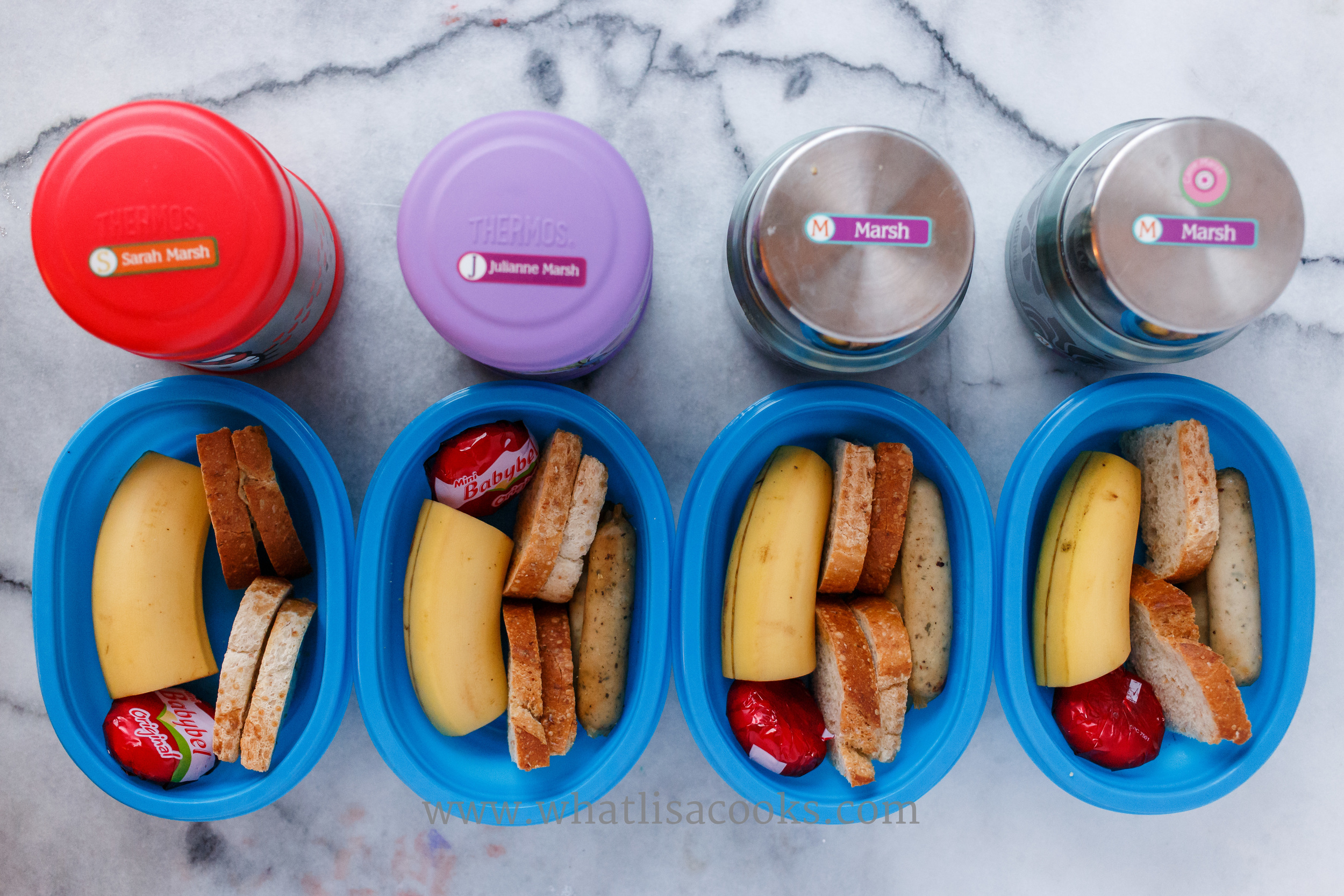 Oatmeal in the thermos containers, with toast, banana, and cheese on the side. We use these  Thermos Funtainer Food Jars  for sending hot foods to school.