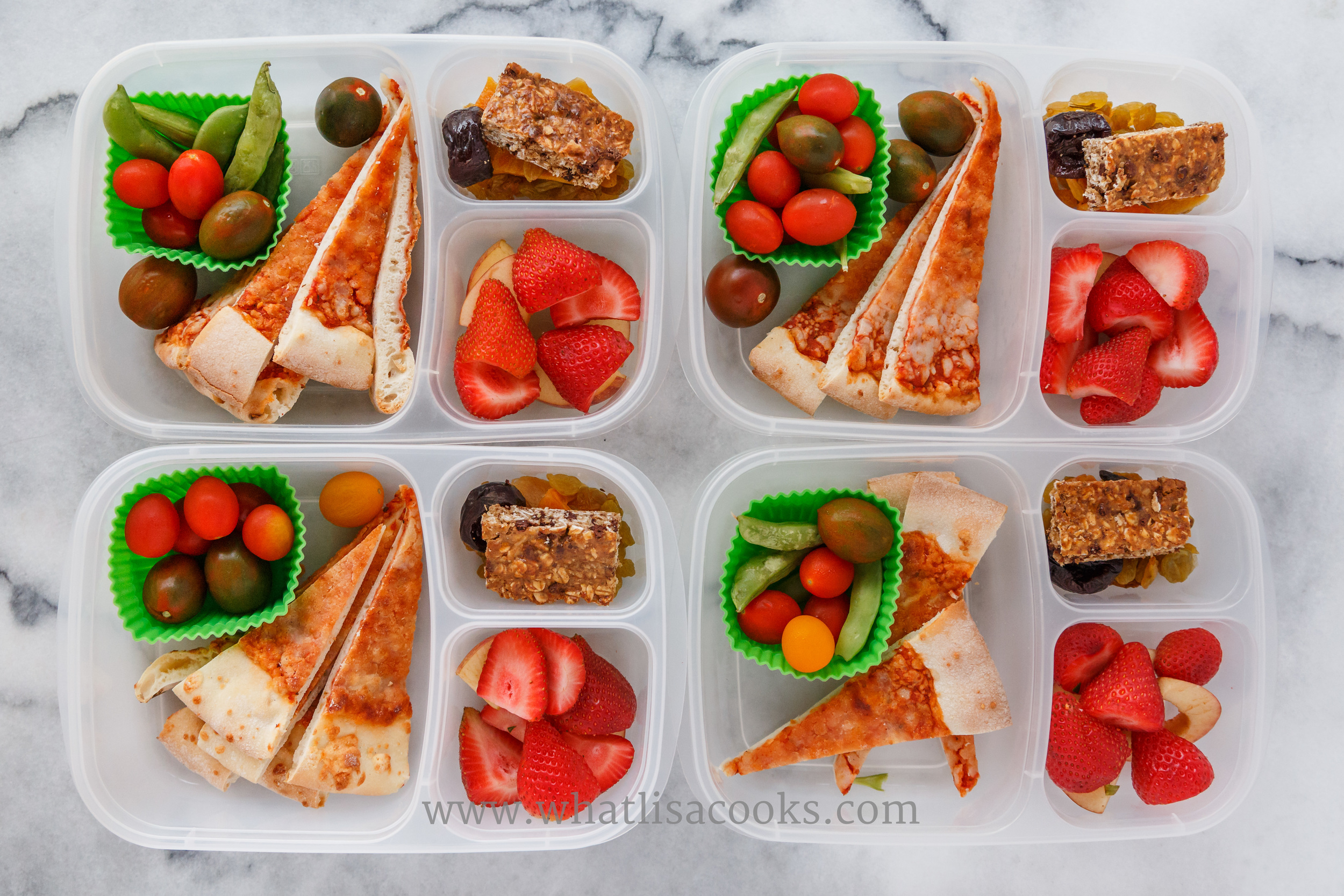 Leftover pizza, tomatoes, sugar snap peas, strawberries, homemade granola bar, raisins, and a prune. Packed in  Easy Lunchboxes .