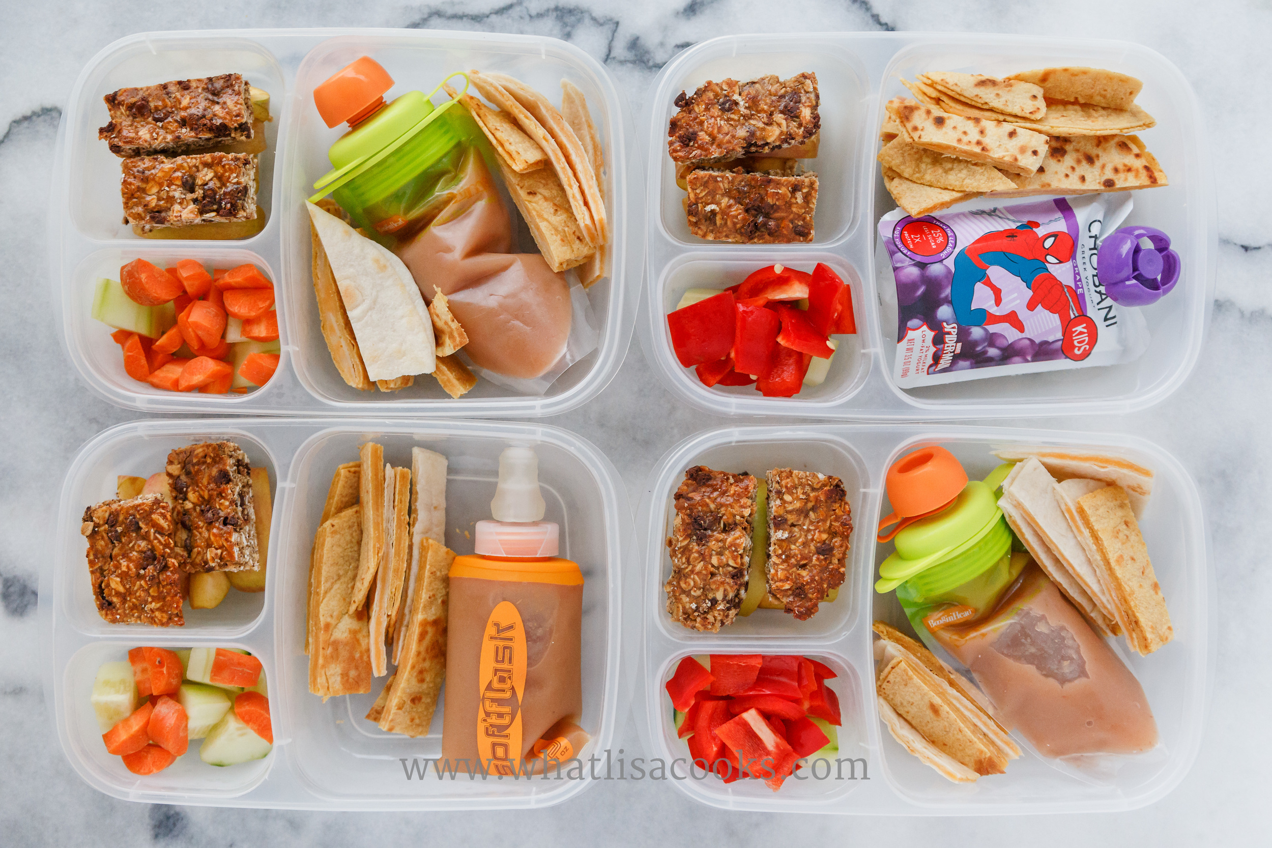 Quesadillas, homemade pear/apple sauce (one has yogurt), homemade granola bars, apples, carrots, cucumbers.  Packed in  Easy Lunchboxes .