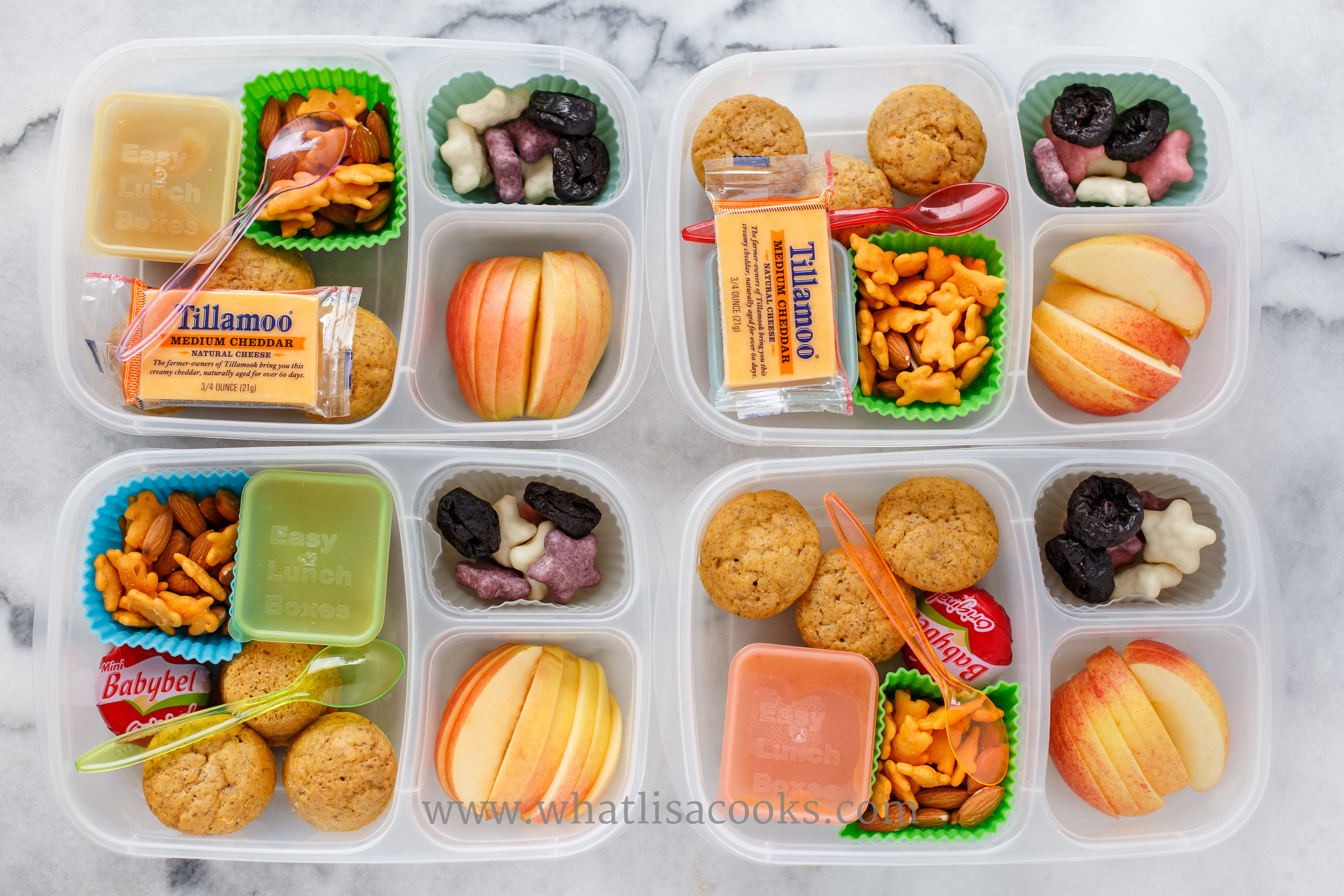 To make super quick lunches, cook up big batches of muffins and freeze. This lunch goes together in no time - muffins from the freezer, homemade applesauce, cheese, crackers, prunes, apples, and a few cookies.