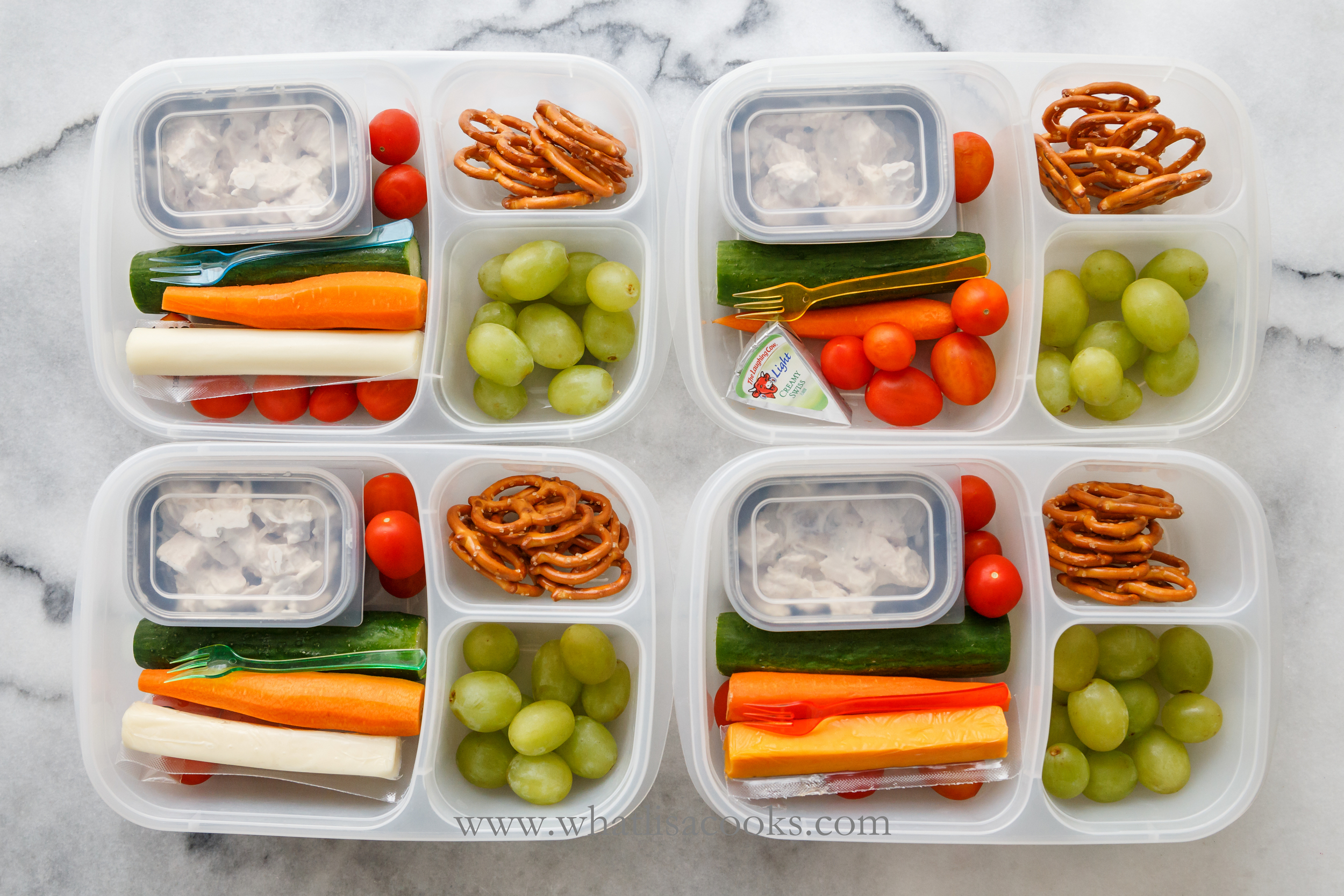 A little chicken salad and a cheese stick for protein, carrots, tomatoes and cucumbers for veggies, grapes for fruit, and a few pretzels for a carb.