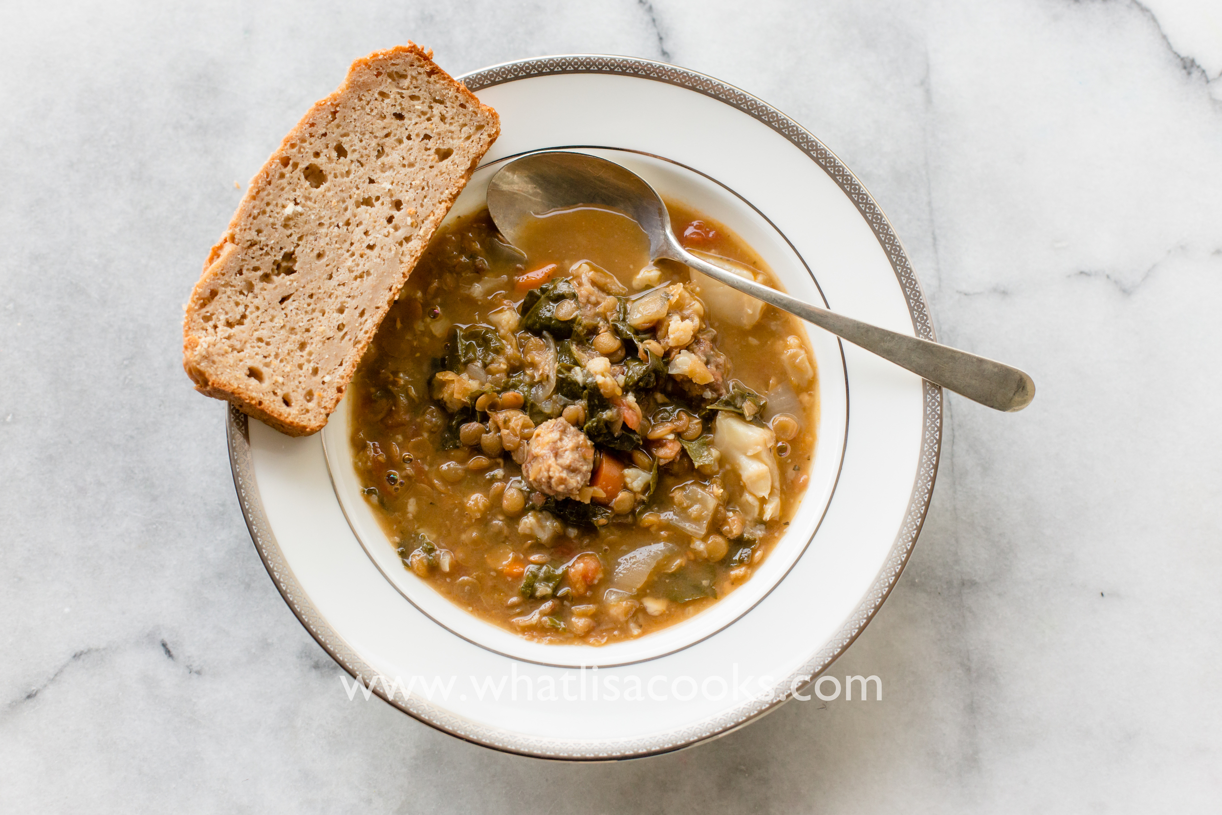 Easy weeknight lentil and sausage soup recipe, made in the slow cooker. From whatlisacooks.com