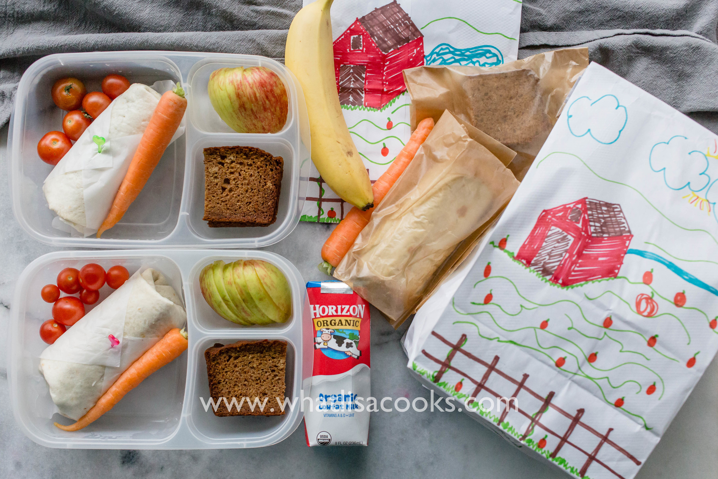Burritos - two have just a piece of parchment around them, and two are in a wax paper bag - either option keeps other foods from touching them. Whole tomatoes, whole carrot, banana bread. Two had sliced apples and two had a whole banana.