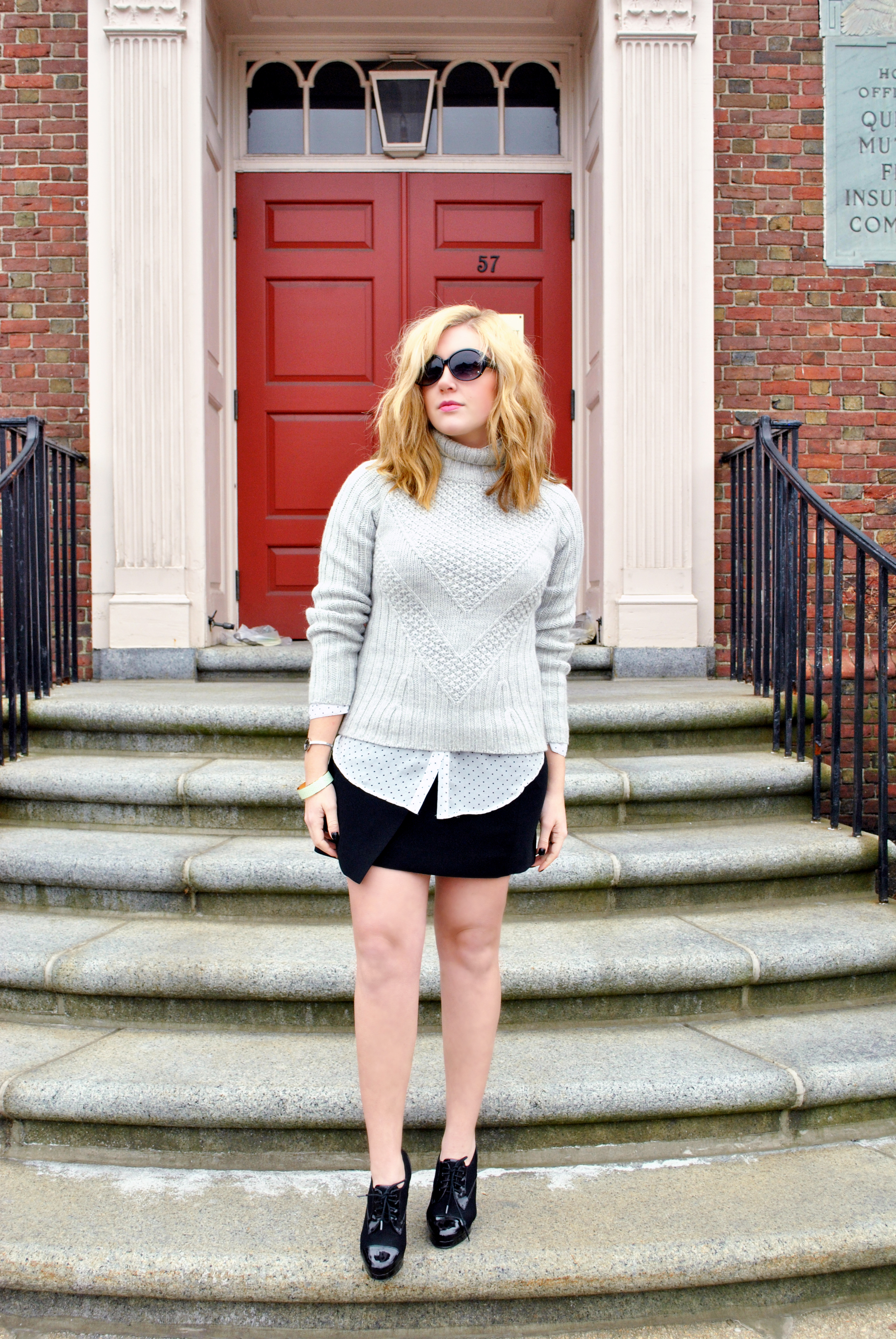 Grey chunky sweater, polka dot shirt, asymmetrical black skirt | thoughtfulwish