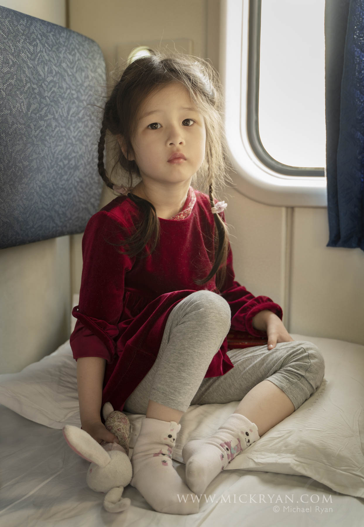 Her first sleeper train. She says she prefers the 'sitting' train. I was kept awake all night by the sound of a pig being slaughtered - which turned out to be a man with the worst snore I have ever heard. Never again.