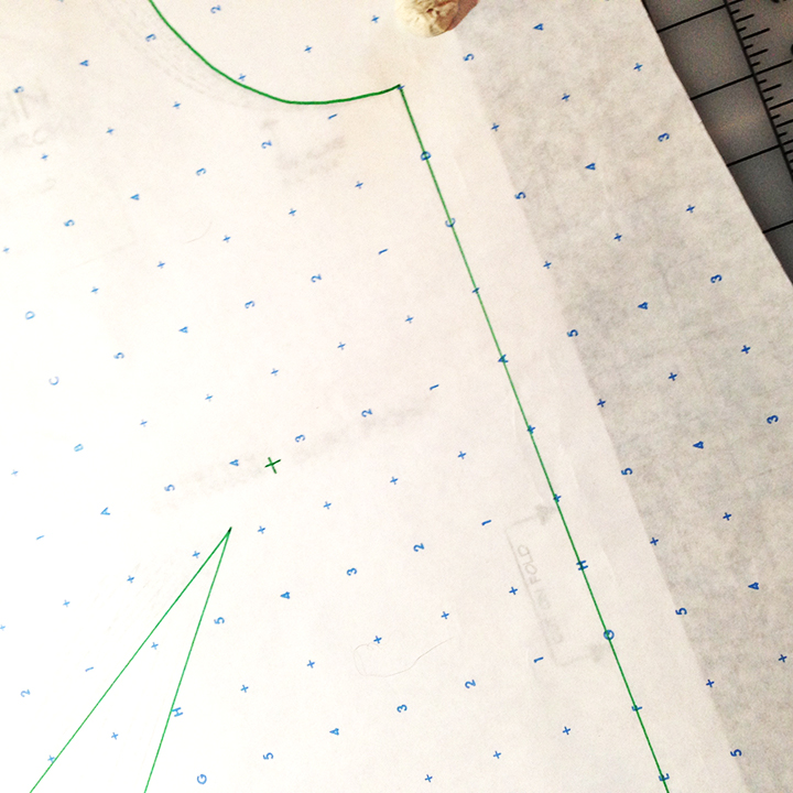 "Here I used alphanumeric pattern paper to trace my pattern. This paper is slightly transparent, a bit heavier than tracing paper, and has letters, numbers, and crosses at 1"" intervals. Here I've lined my fold line (now CF) with these markings."