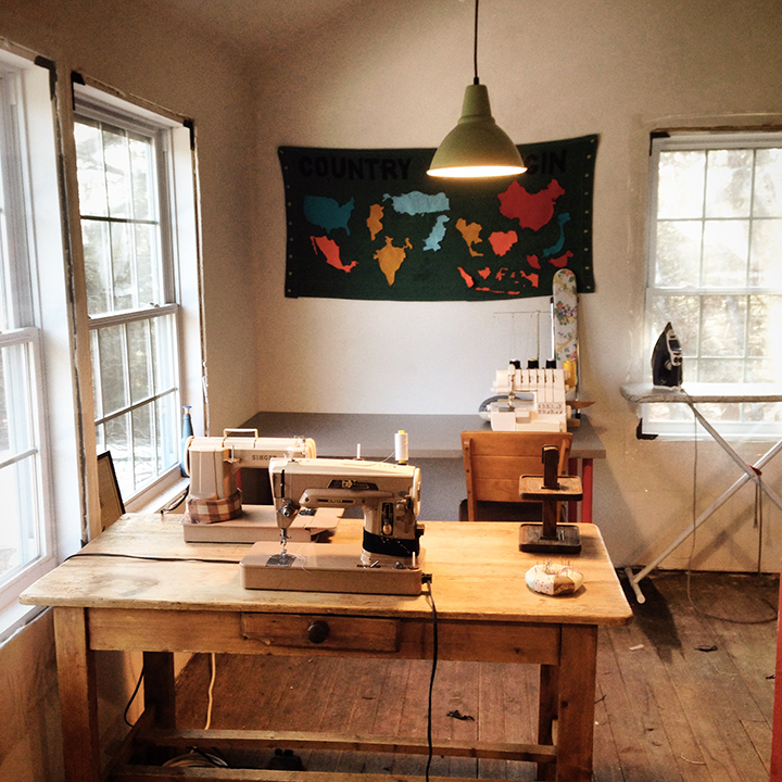 Two sewing desks, 2 of 5 vintage straight stitch/zig zaggers pictured. We still need to frame out the windows...right now they're still covered in winterizing plastic.