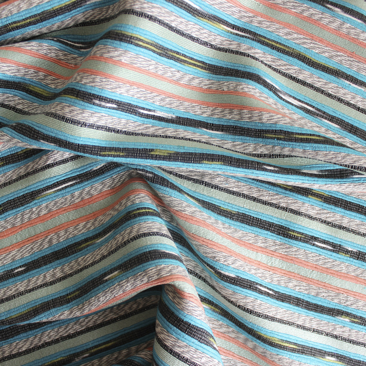 I love this woven stripe viscose silk from  Blackbird Fabrics . It comes in two colors ways and would be perfect for an A-frame pencil skirt.