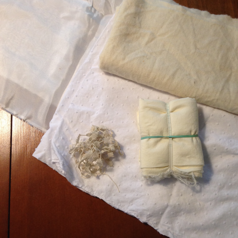 Silk habotai, cotton swiss dot, wool twill, cotton lawn (in the shibori bundle), and cotton lace.