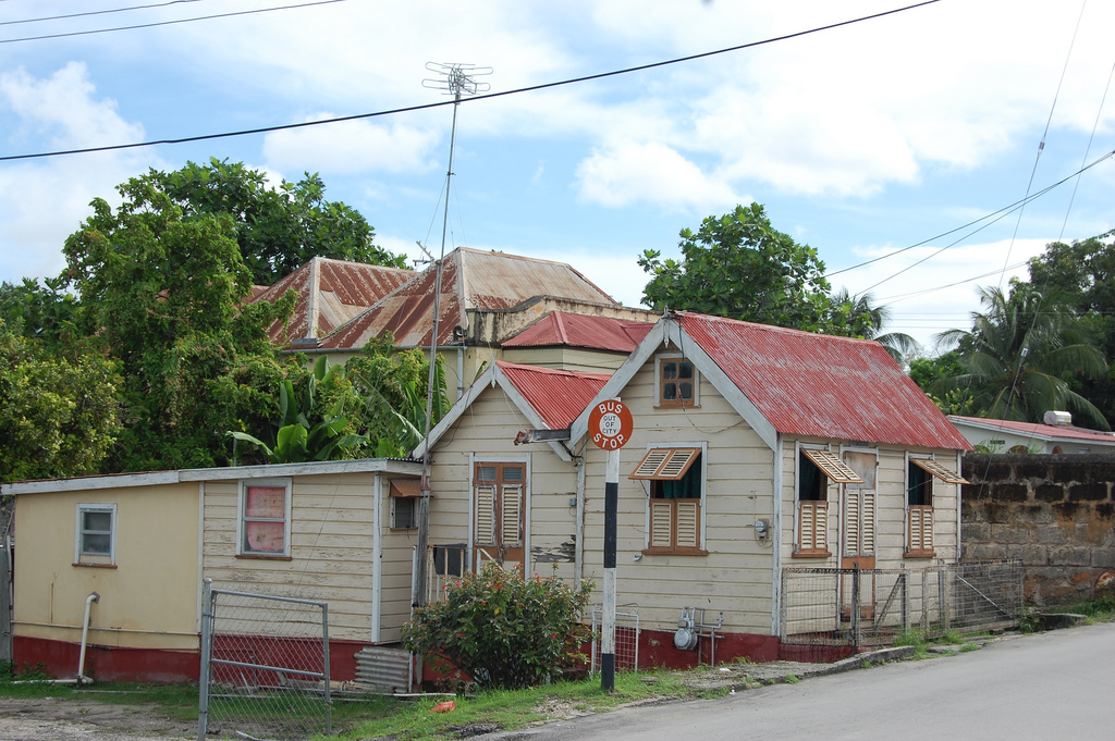 I didn't take this one...it came from wikimedia. The car was moving too fast for good pictures. The original Chattel house and addition are on the right, with the back two additions possibly added later.