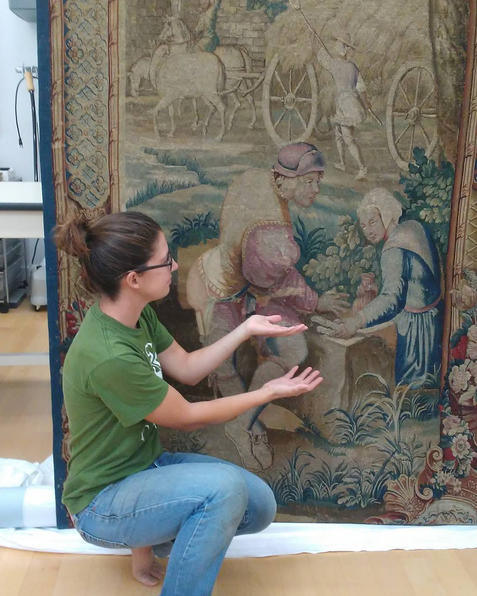 A restored tapestry with an agricultural theme.