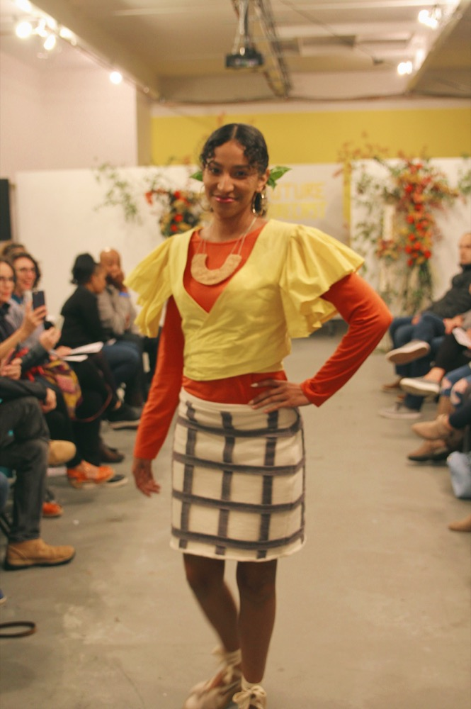 Dariana wears a cotton terry skirt with a check pattern made from fabric scraps and a handmade felt necklace. The yellow top is by Nathalia JMag (dyed with turmeric) and the long sleeve undershirt is secondhand.
