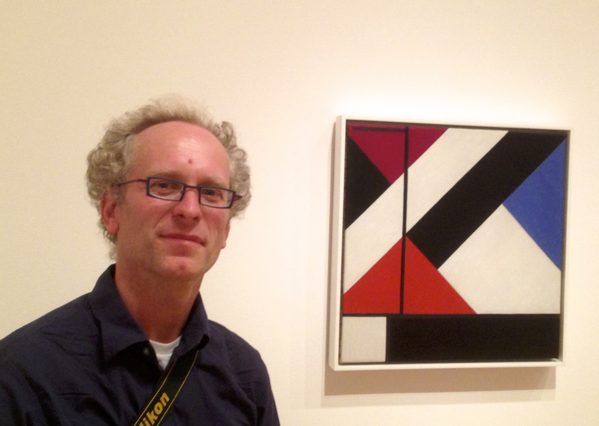 Stefan Timmermans, in front of another painting used in the book.