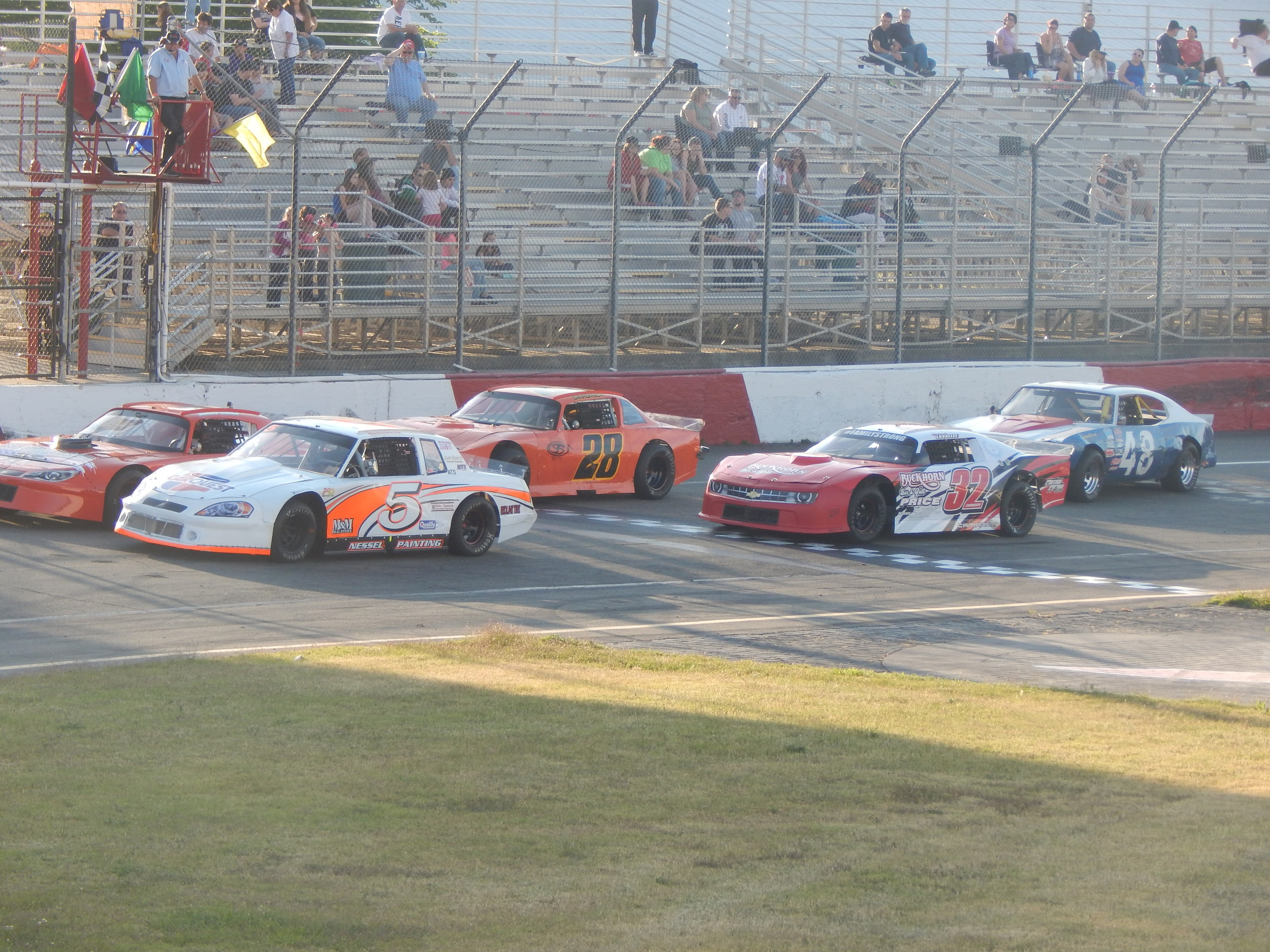 The Street Stocks lining up for one of their races ( Jeremy McDonald 65 Sports)