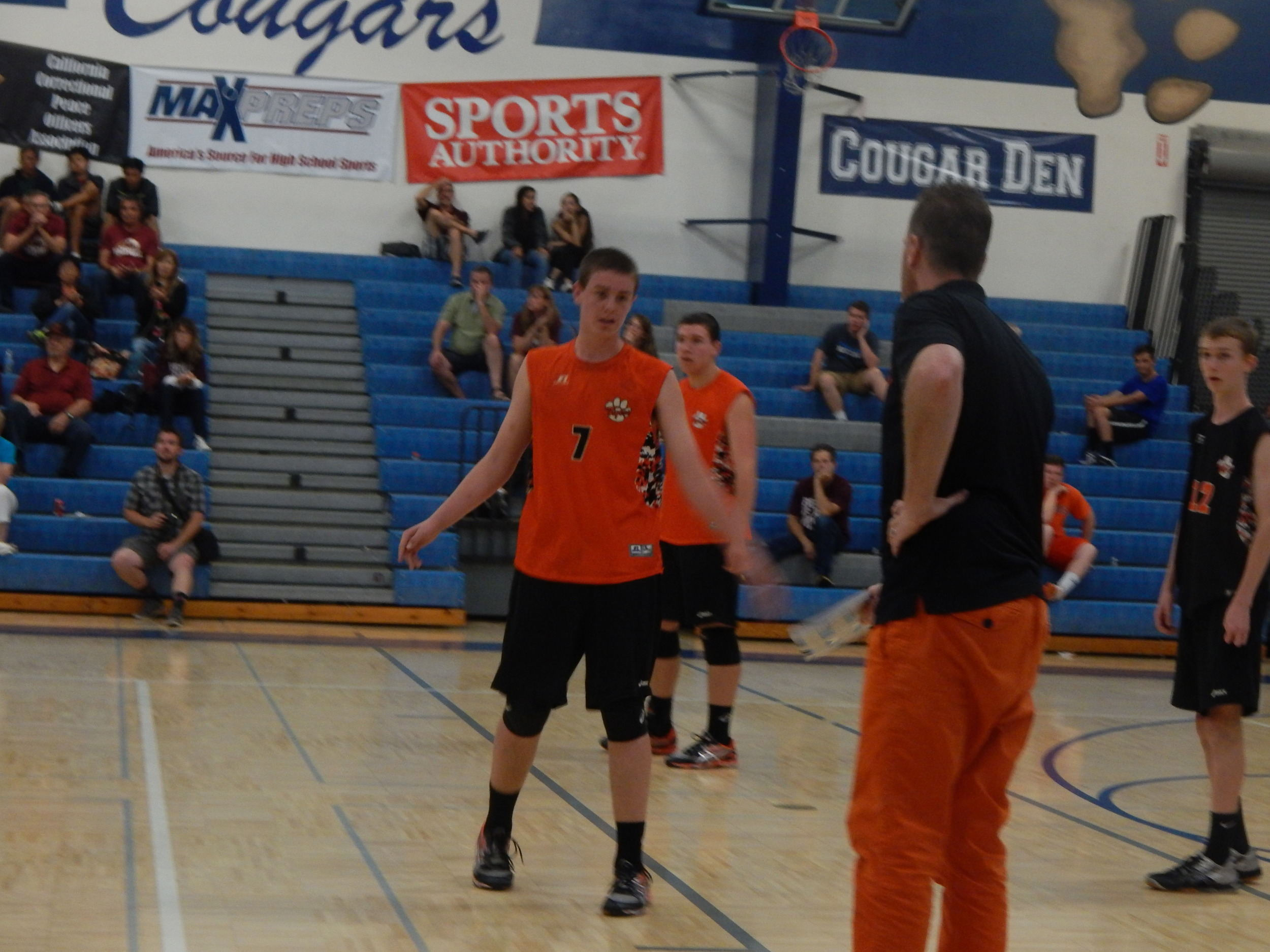 Head Coach Jason Cole and Jacob Cole share a few words in between plays on the court ( Jeremy McDonald- 65 Sports)