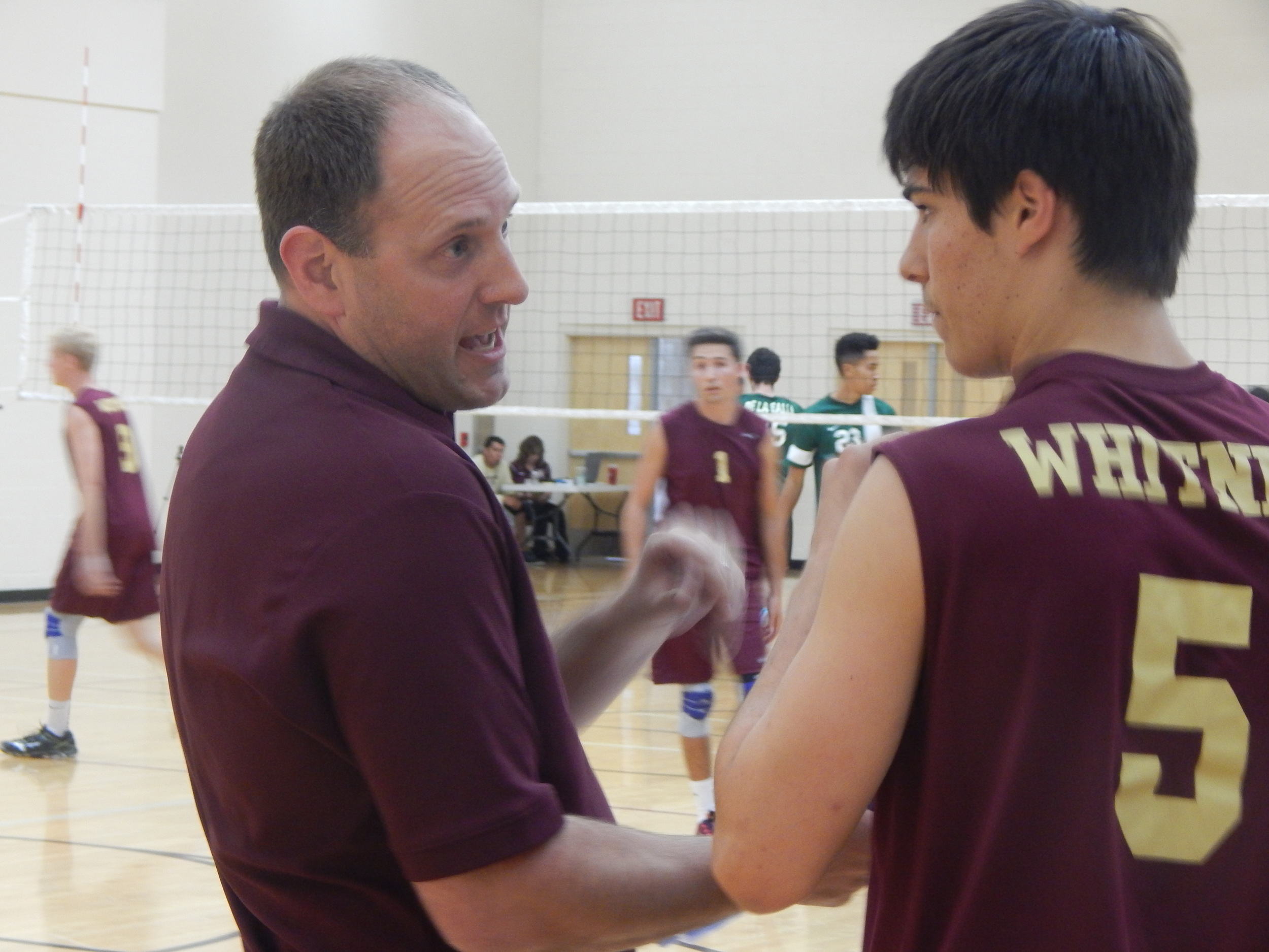 Whitney Head Coach Erich Means and Justin Otus talking over a previous play during the first set of Tuesday night match versus De La Salle ( Jeremy McDonald-65 Sports)