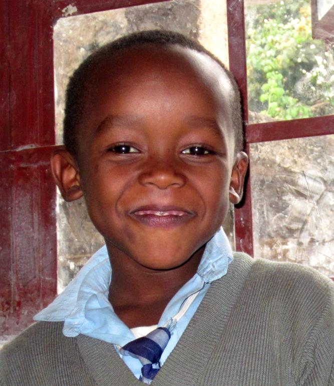 Johnson-Laizer   Age: 11 years old    Favorite Subject: Math    Favorite Activity: Swings    Favorite Food: Ugali