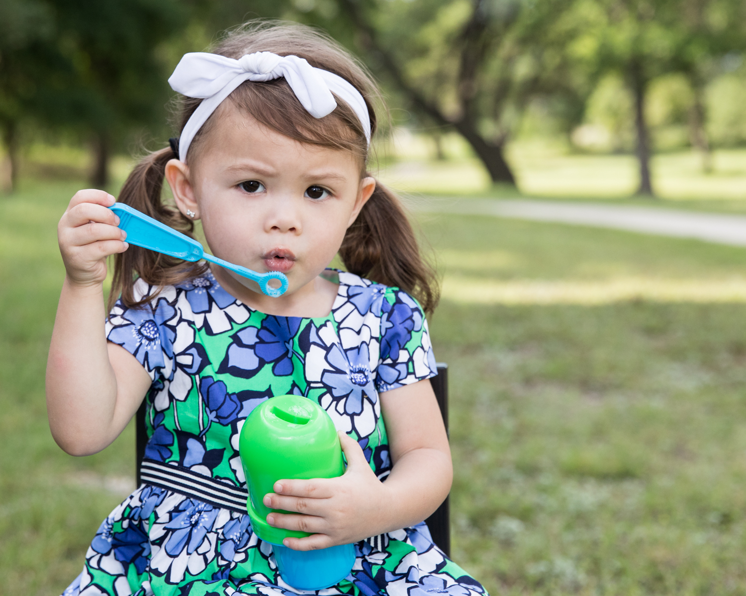 Bubbles are a great prop! Unless the two year old feels like she needs to hold the bubbles!