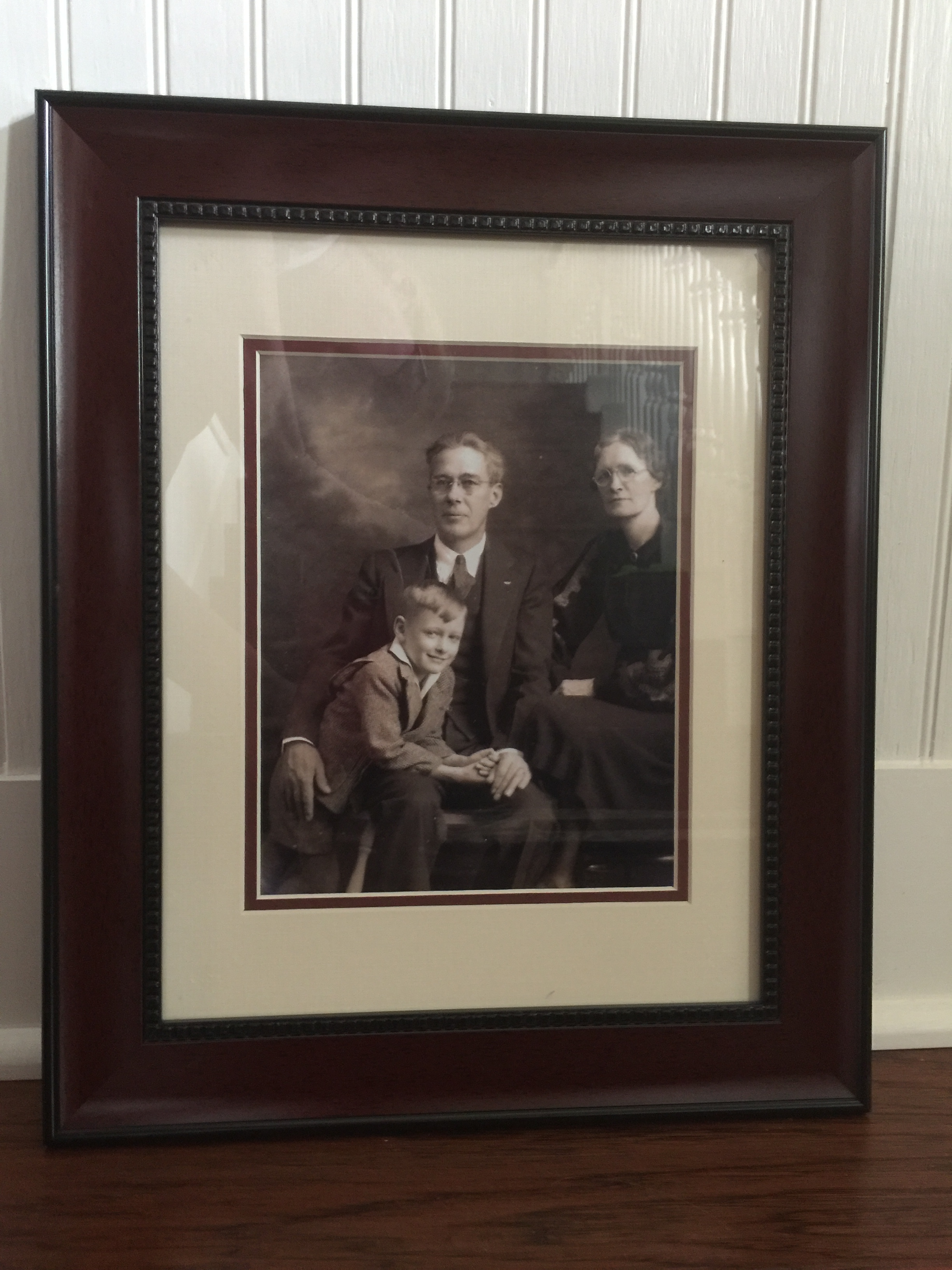 My father and his parents. I scanned the original photo and printed this heirloom photograph.