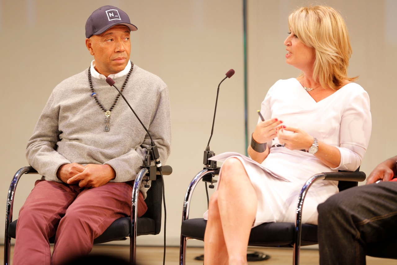 Jennifer on a panel with Russell Simmons