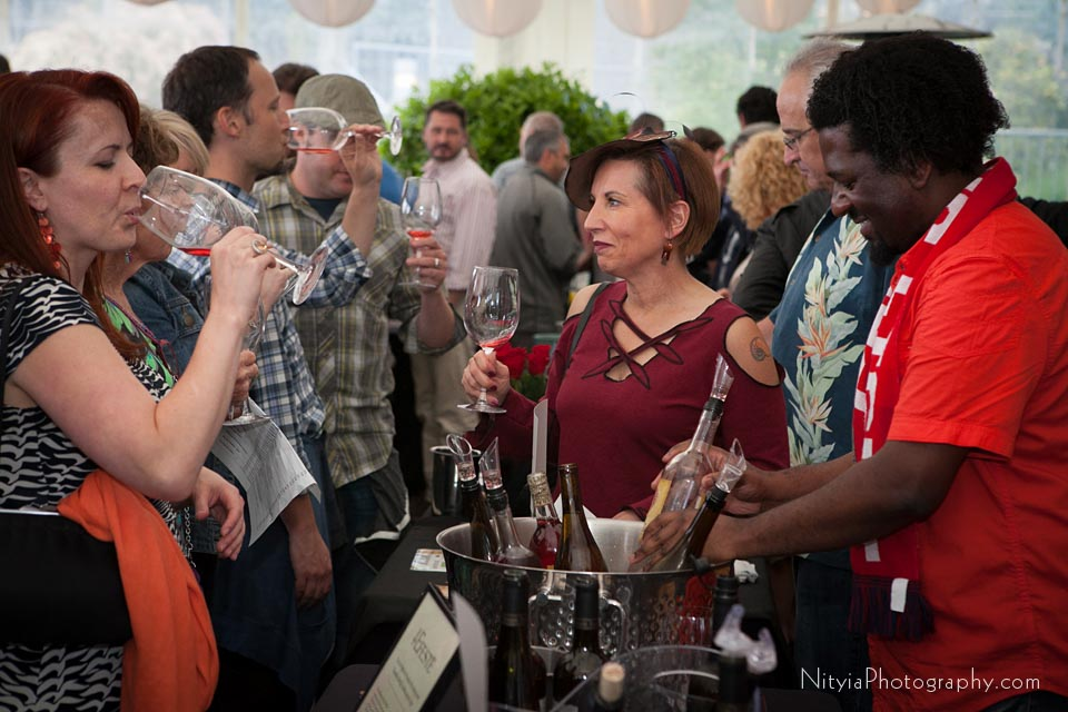 people sampling wine from vendor at corporate function