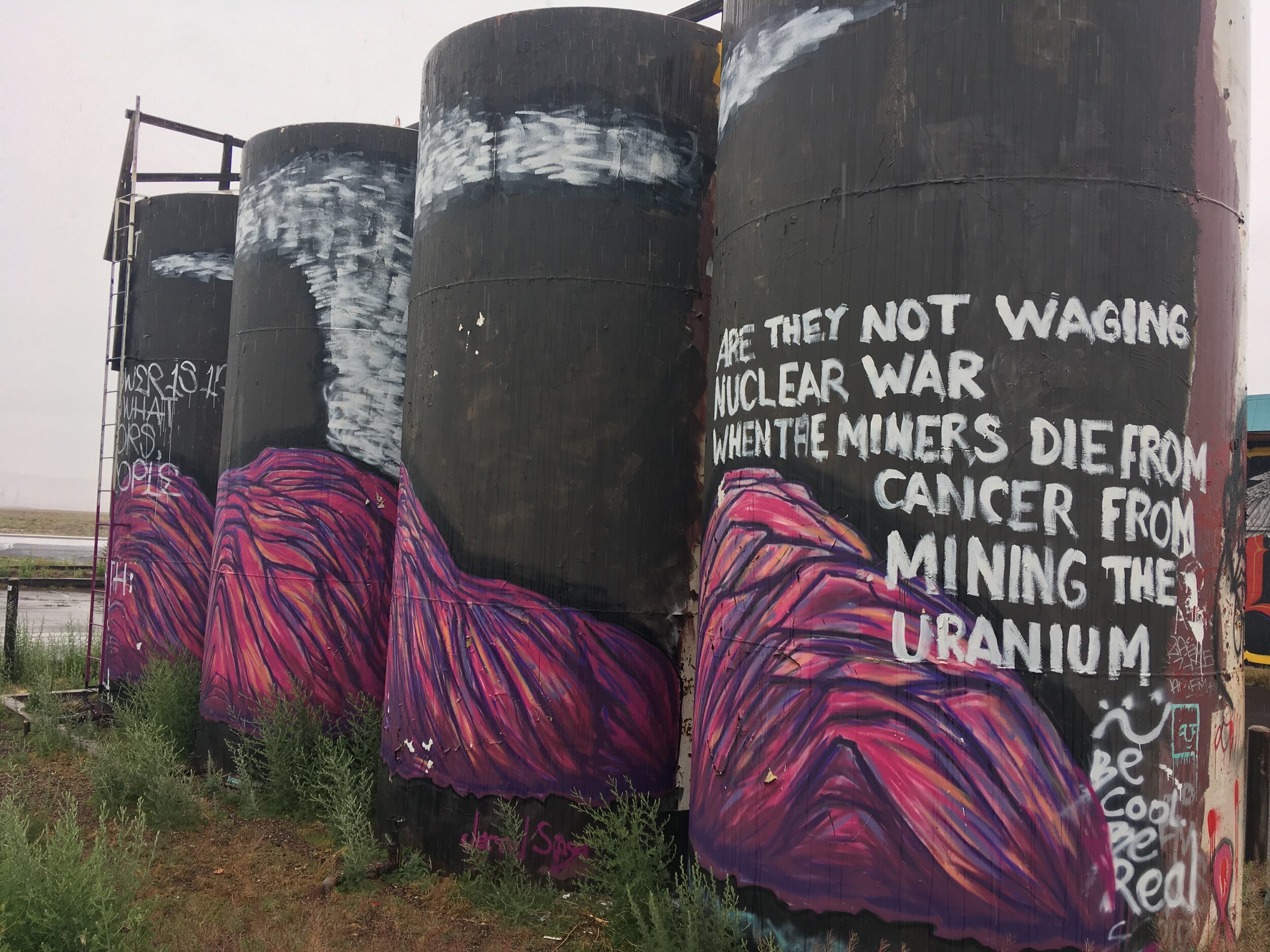 """Artist Jerrel Singer's mural near Grey Mountain, Arizona on the lands of the Navajo Nation. """"Are they not waging nuclear war when the miners die from cancer from mining the uranium?""""  Read more about Jerrel's work"""