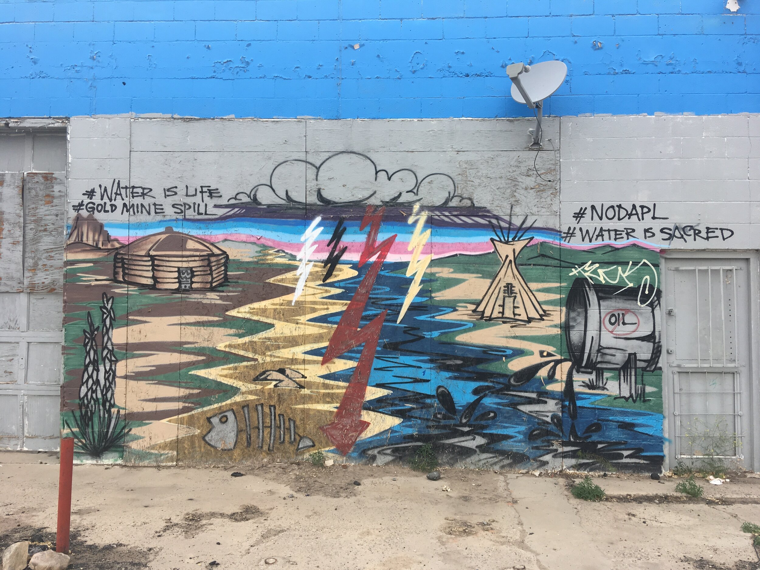 """""""#waterislife #goldminespill #noDAPL #WaterisSacred"""" Street art/Mural in Shiprock, New Mexico. Navajo Nation. Artist unknown. (If you know the artist please contact me at sarahalisabethfox@gmail.com!)"""