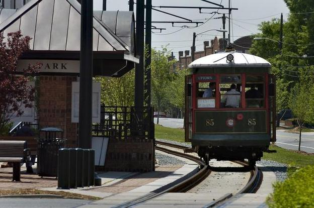 Charlotte's last original streetcar No. 85, gliding through South End in 2002. The car is owned by the Charlotte-Mecklenburg Historic Landmarks Commission and has been committed to Lakewood Trolley for its use along the former P&N Railway line near uptown.