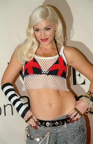 Our platinum princess rocking some ultra funky duds and flaunting her notoriously perfect abs!