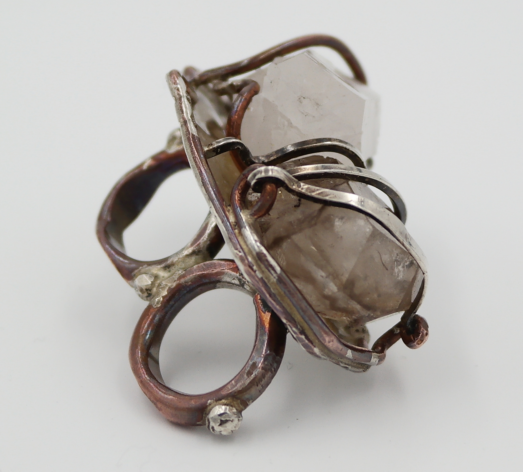 I had had this big guy made by an artist in Atlanta. It's clear and smoky quartz in sterling silver and copper.