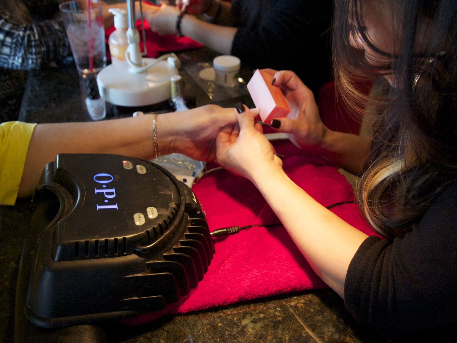 A customer receives a gel manicure at Bella Salon and Spa