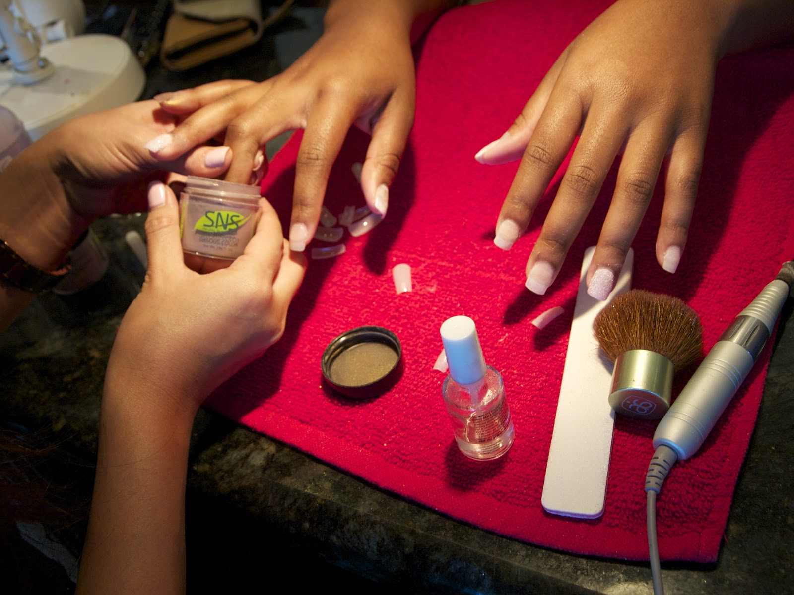 A manicurist gives a customer a NexGen manicure