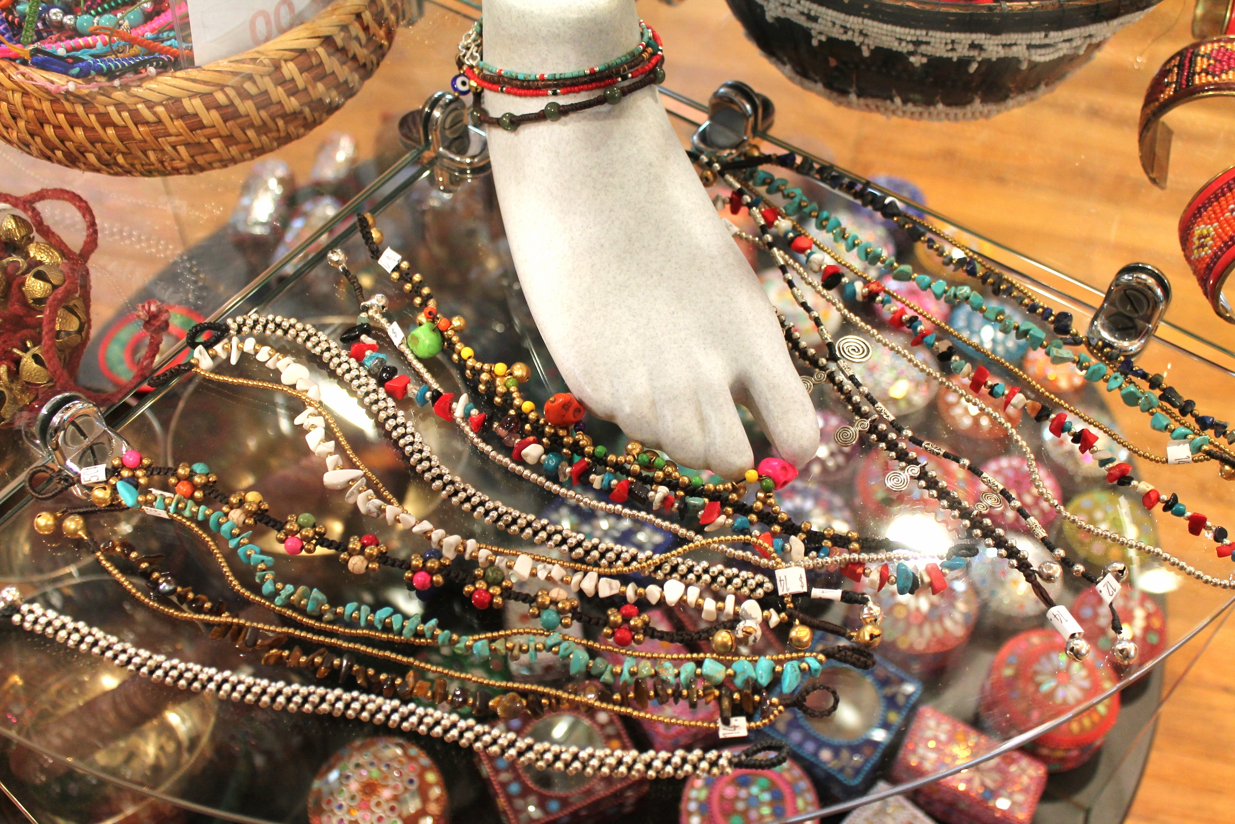 A festive array of stone and metal anklets from India and Thailand.