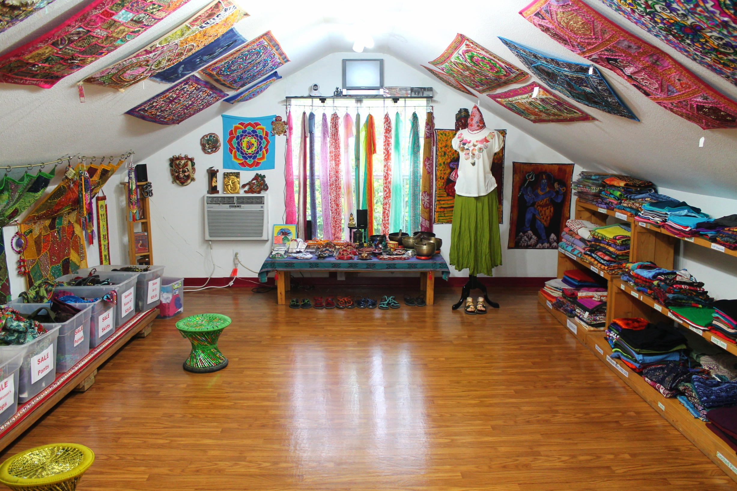 The upper floor of Juliet's Jewels houses a wide selection of clothes, scarves, tapestries, wall hangings, and even harder to find items such as authentic meditation singing bowls from Nepal.