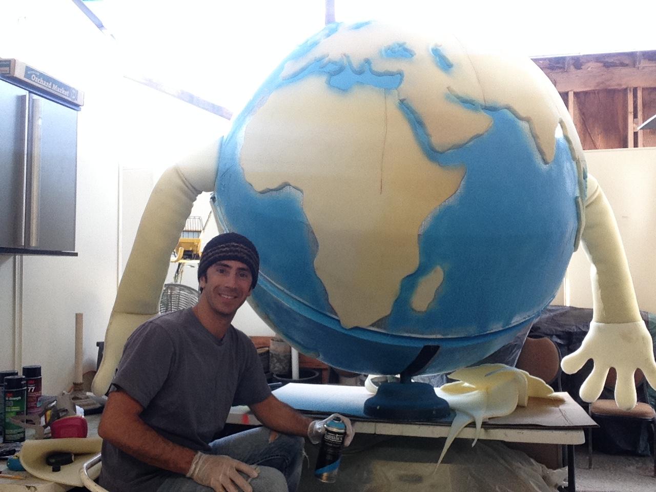 Matthew McAvene Paints 6' Earth Day Puppet.JPG