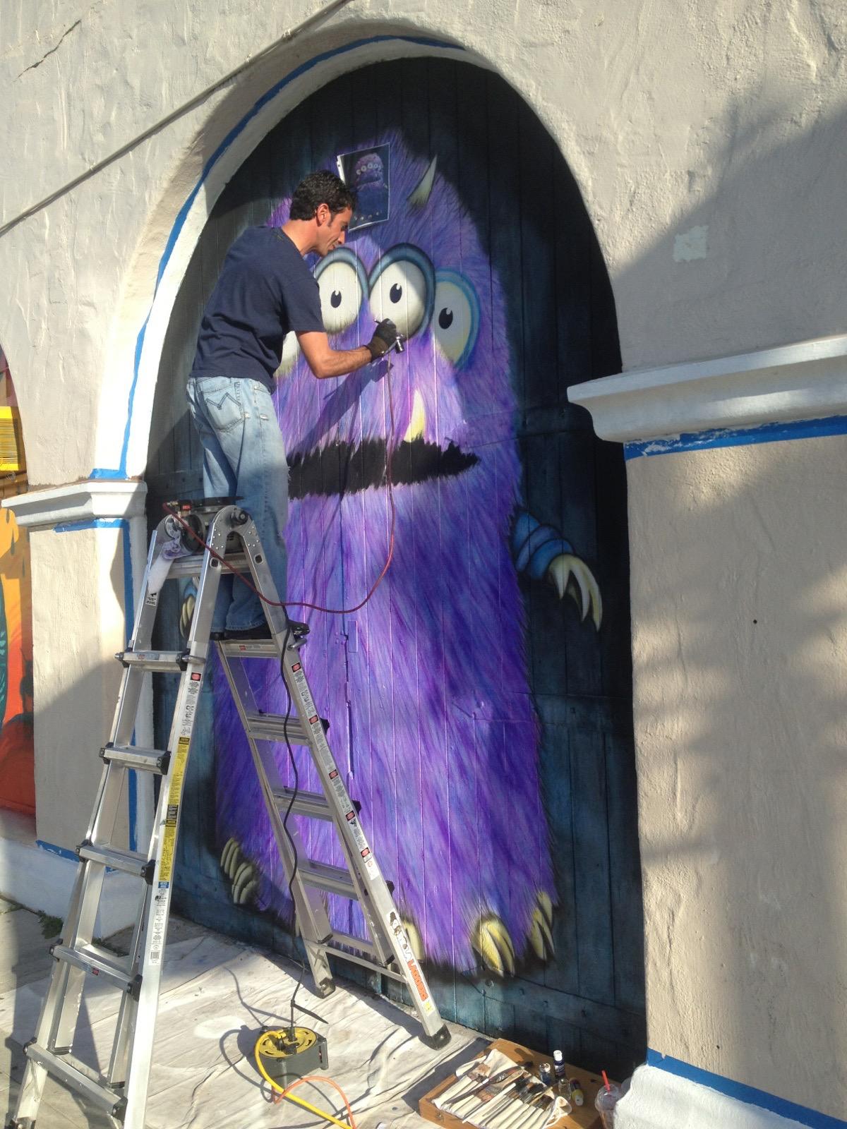 Matthew McAvene paints a 12' Monster Mural.jpg