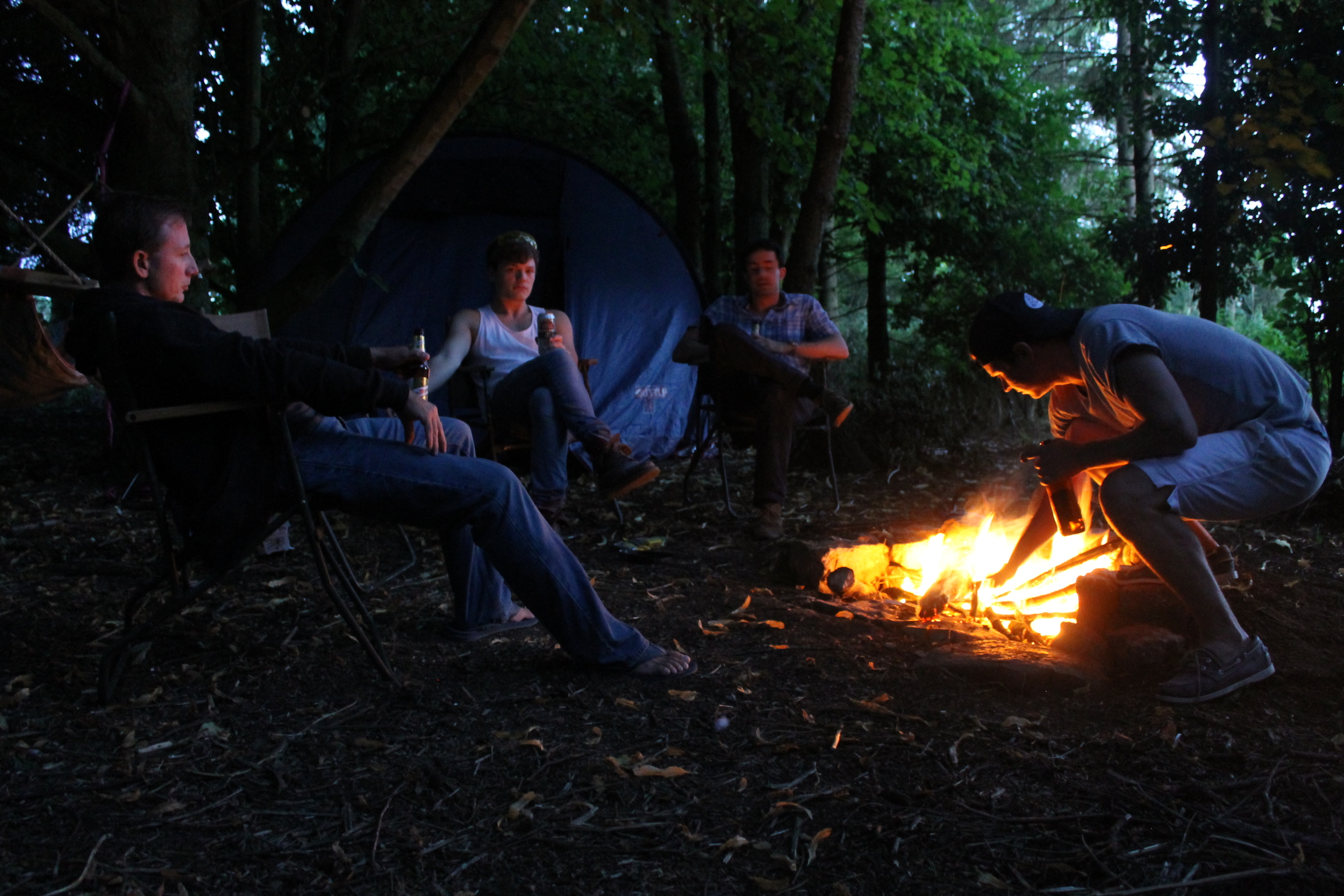 Relaxation by the campfire after a day's carving.