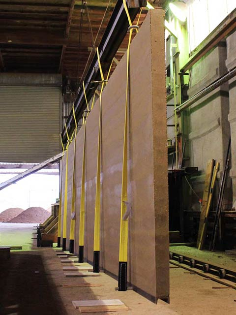 Rammed Earth Works specializes in factory made pre-cast rammed earth for situations where traditional 18-24 inch thick walls aren't feasible.
