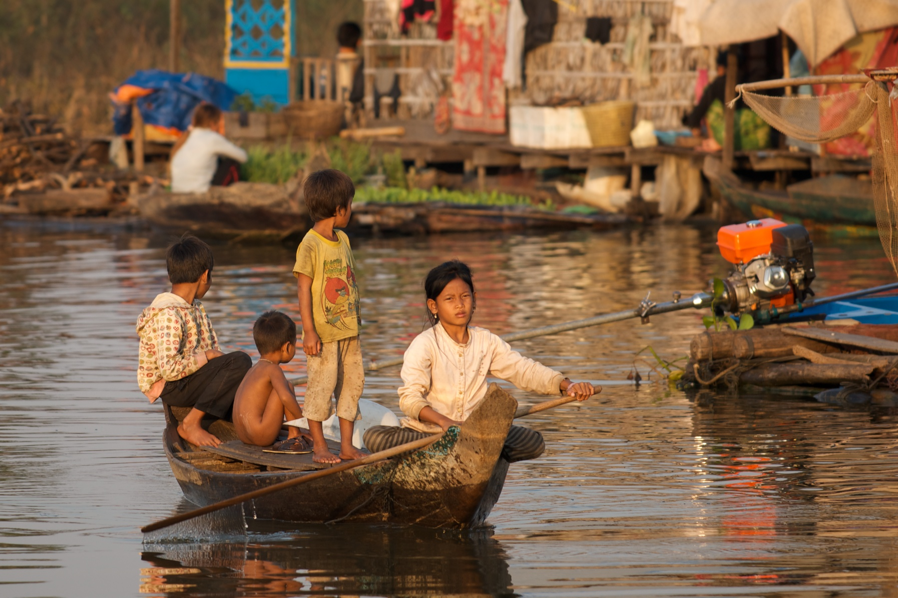 A girl paddles across town. Floating village, Tonle Sap, Cambodia.