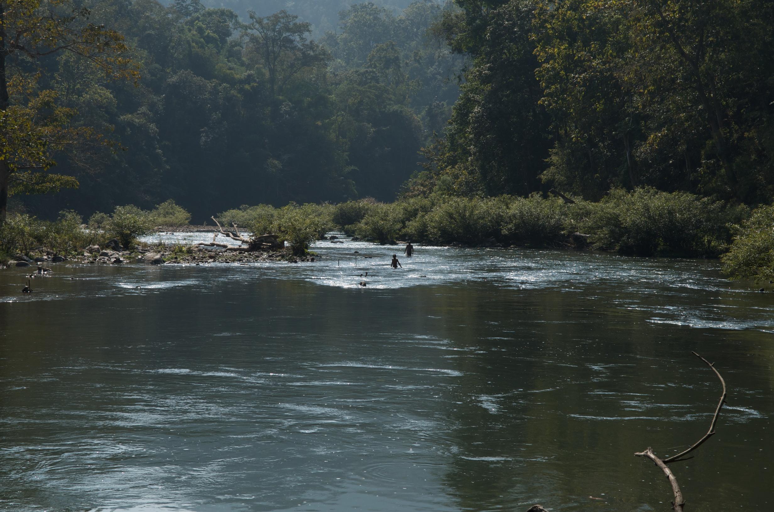 Two ethnic Karen boys go fishing after school.   Ngao River, Thailand