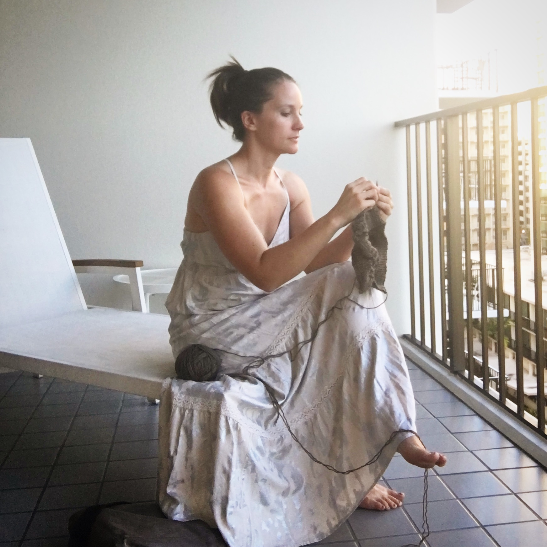 Knitting a new design on a balcony in Hawaii.